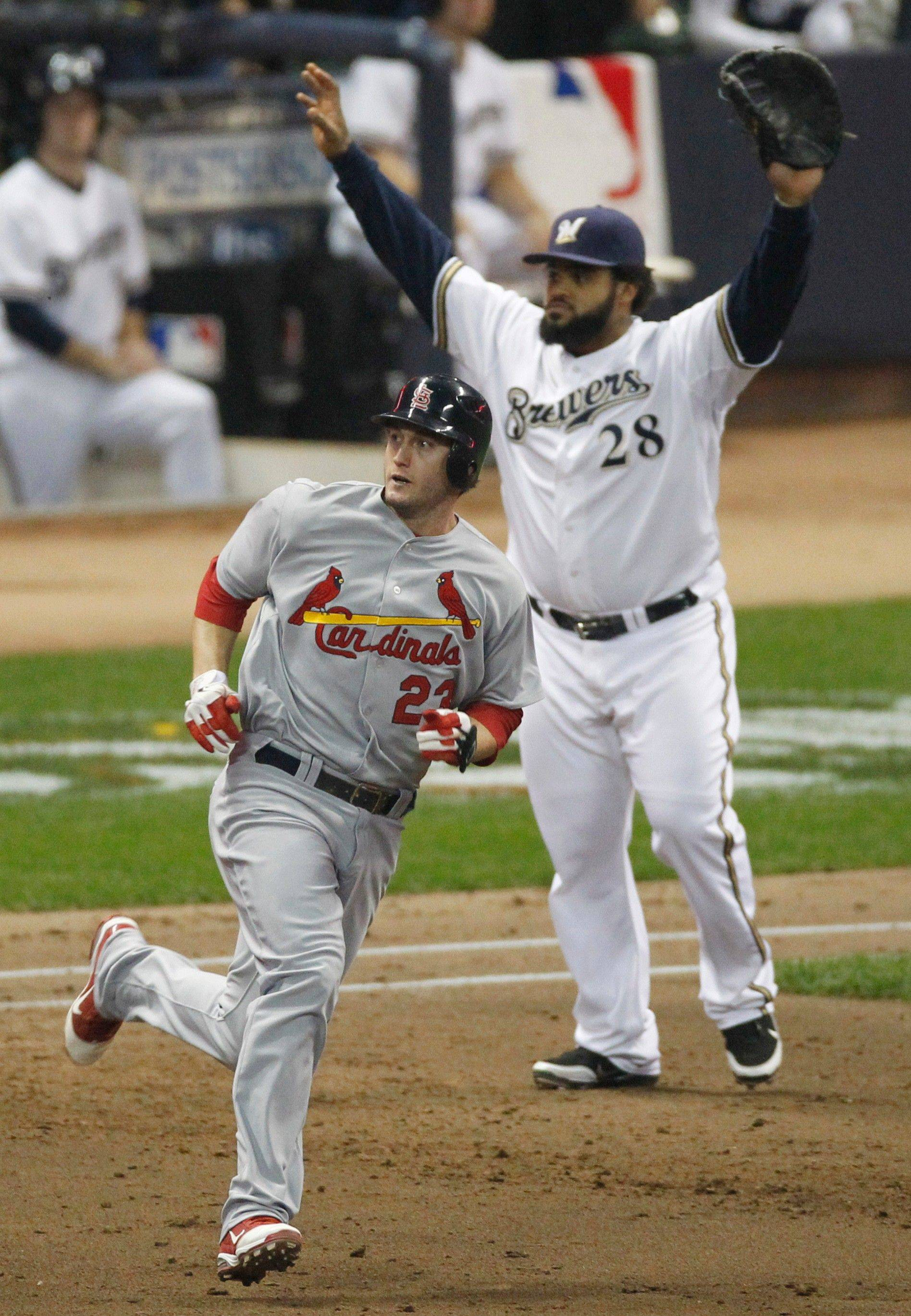 Milwaukee Brewers first baseman Prince Fielder watches as St. Louis Cardinals' David Freese hits a double during the third inning on Sunday night. Freese was named the series MVP.