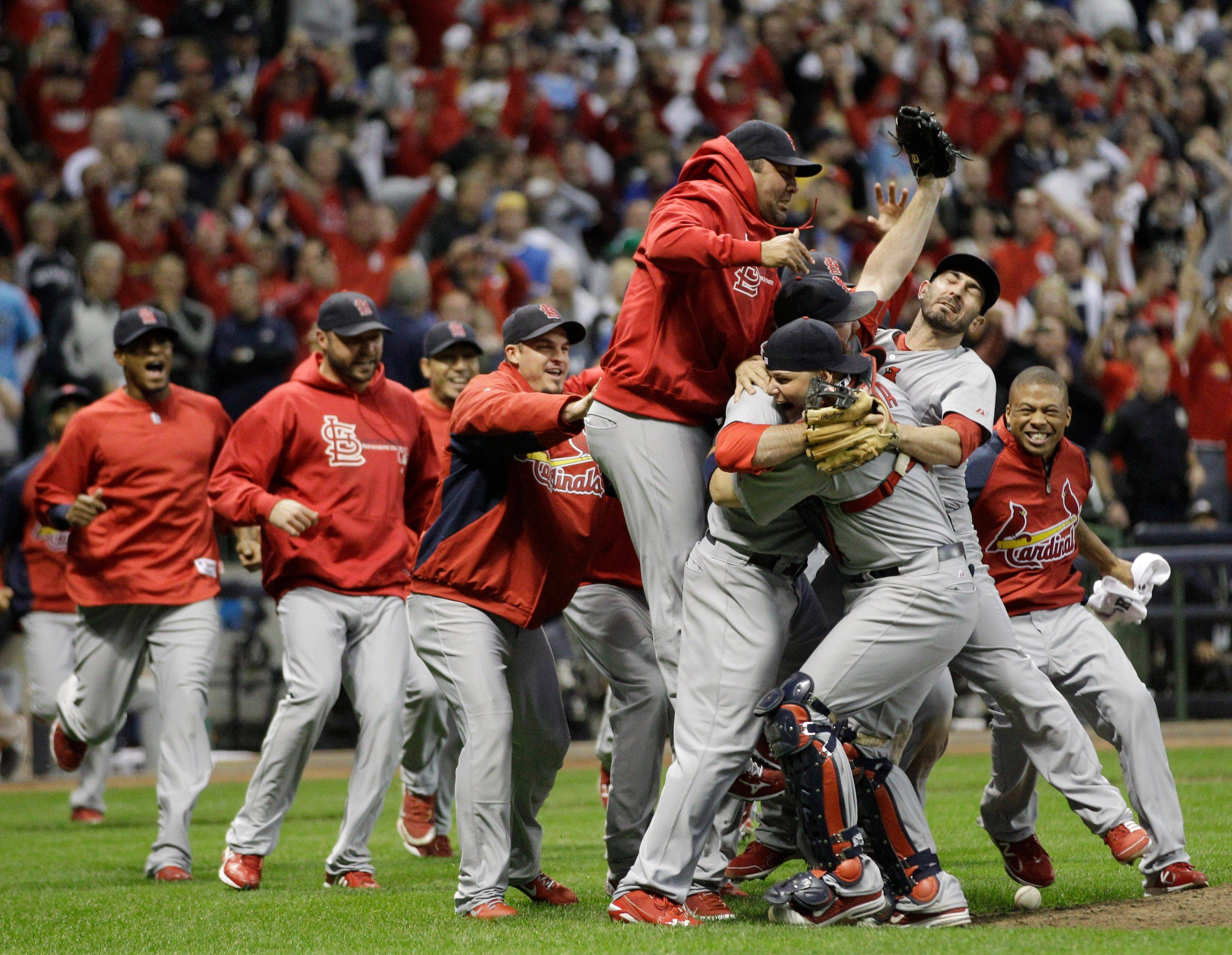 The St. Louis Cardinals celebrate after Game 6 of baseball's National League championship series against the Milwaukee Brewers on Sunday.