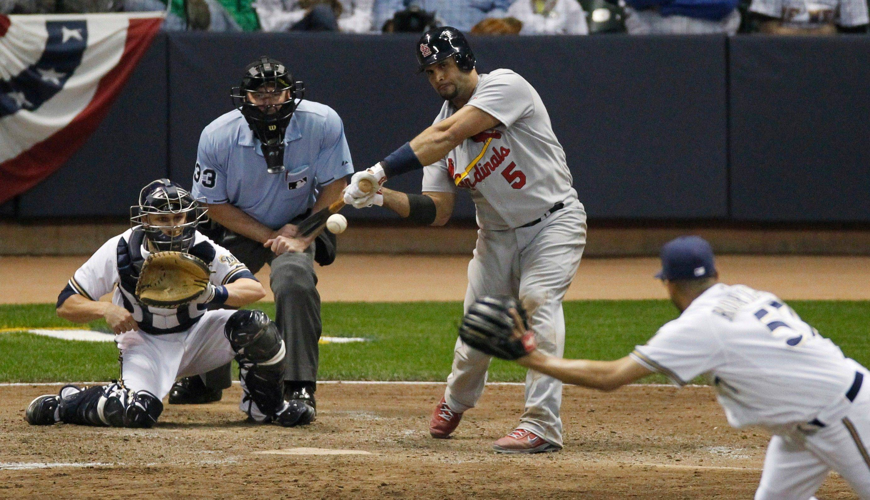 Albert Pujols hits an RBI single off Milwaukee Brewers relief pitcher Francisco Rodriguez.