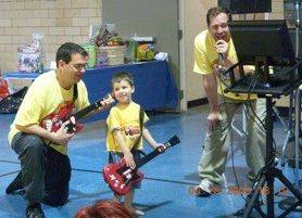 John Cuccinotto, from left, co-chairman of the Hoop-a-Thon fundraiser, plays music with his son, Ryan, and brother-in-law Paul Tyrrell at the event.