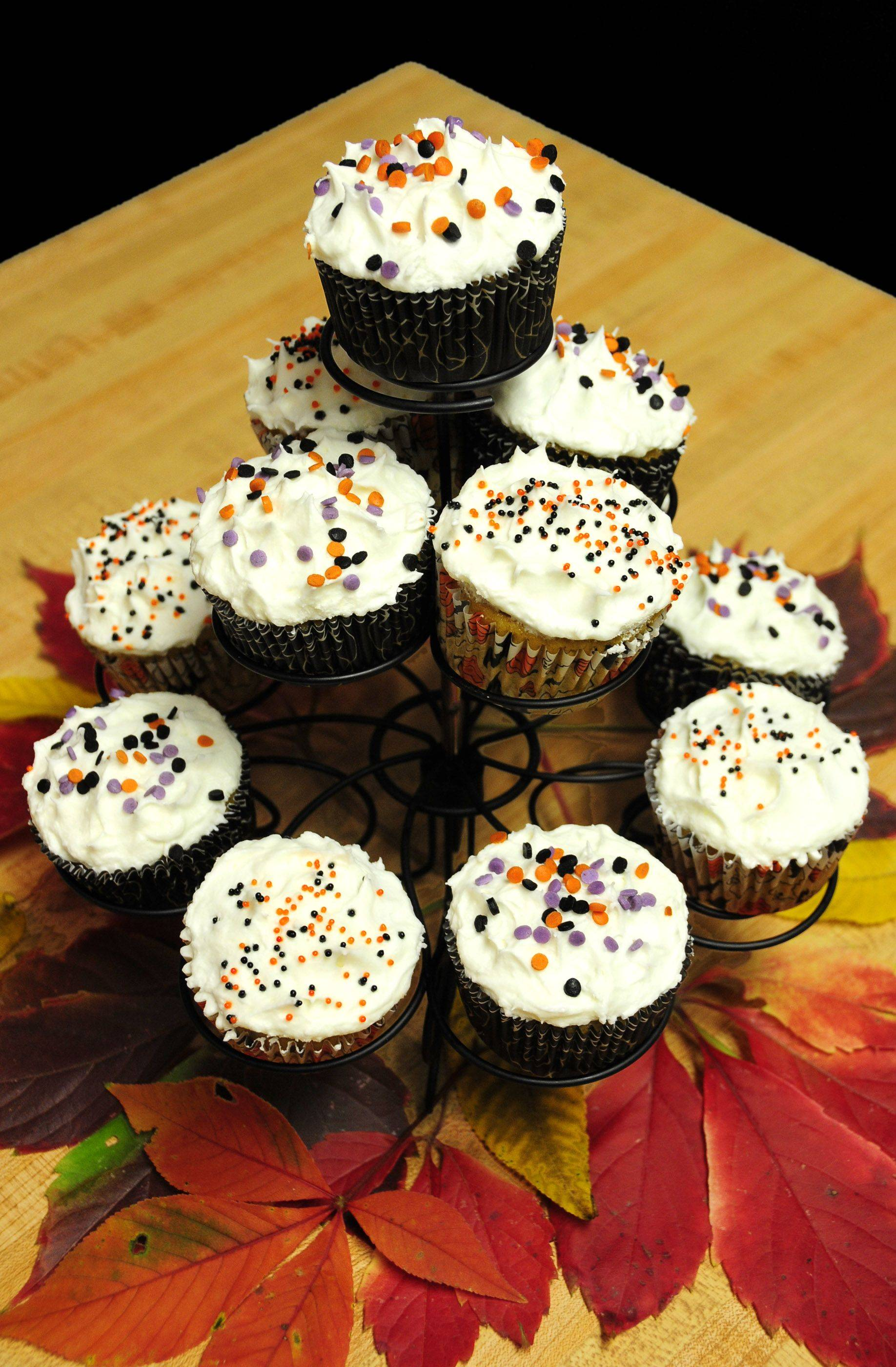 Treat goblins young and old to Halloween Pumpkin Cupcakes.