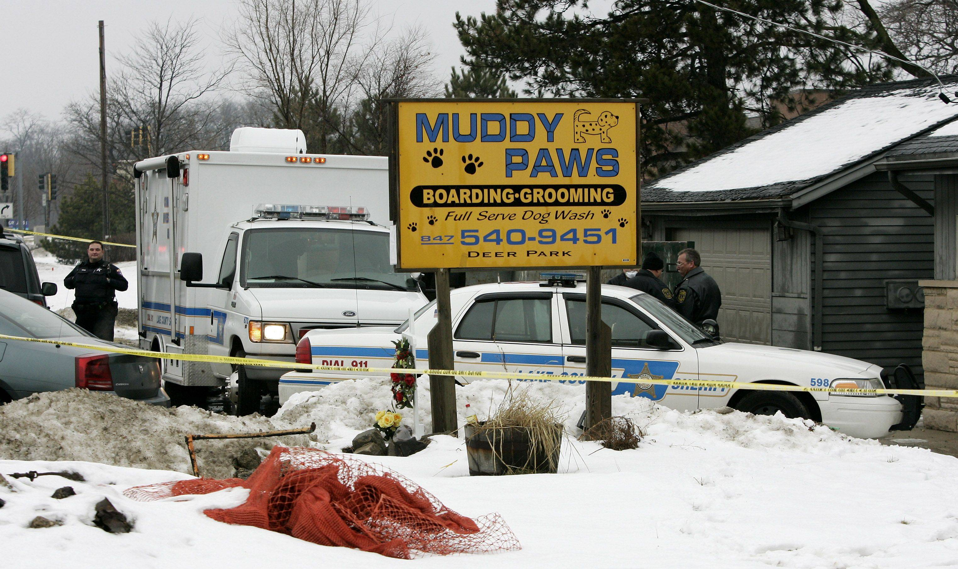 Lake County Sheriff's investigators and Kildeer police investigate the scene at Muddy Paws shelter on Rand Road in Deer Park.