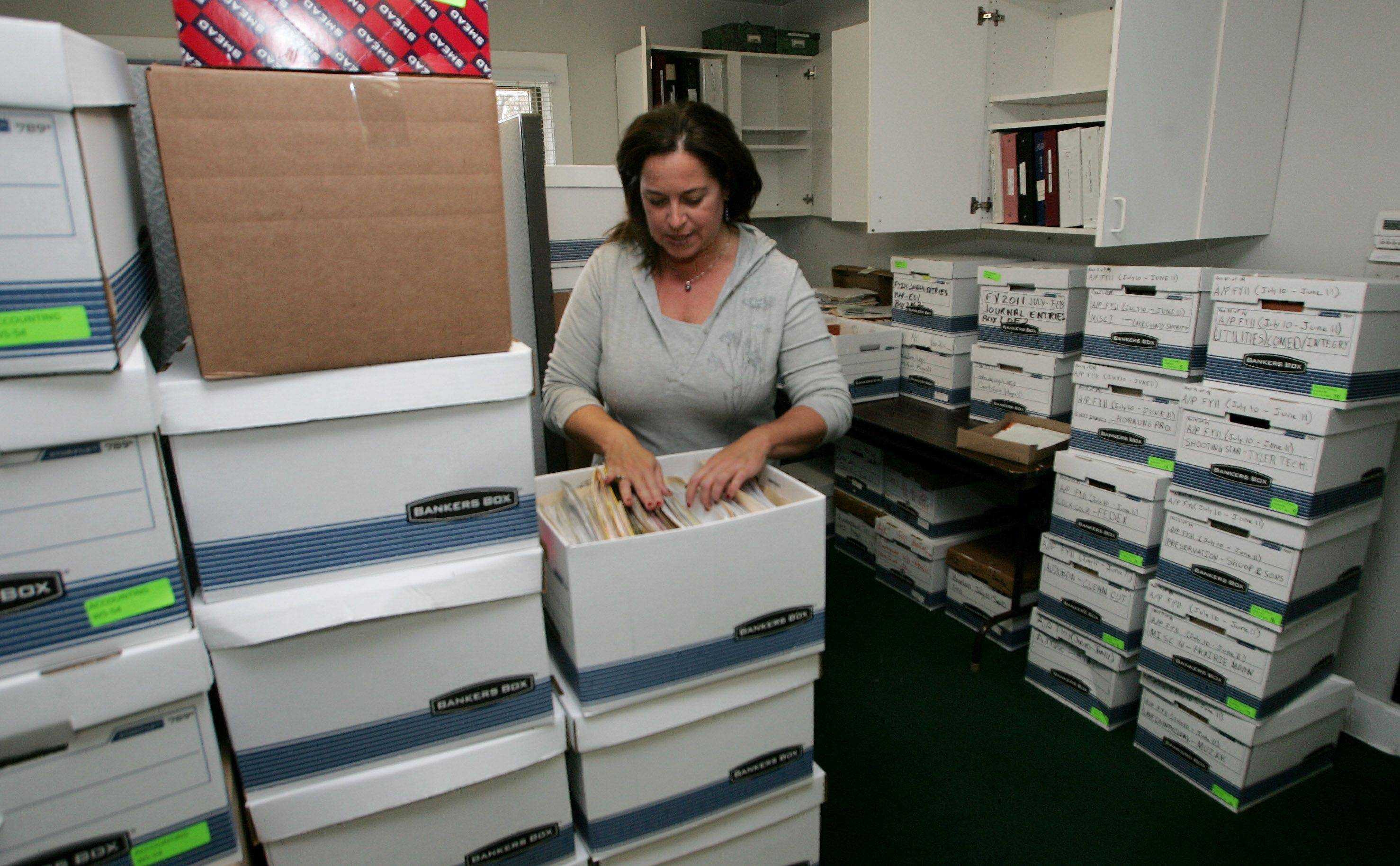 Administrative coordinator Maureen Clausen packs in preparation for the move to the Lake County Forest Preserve District's new headquarters.