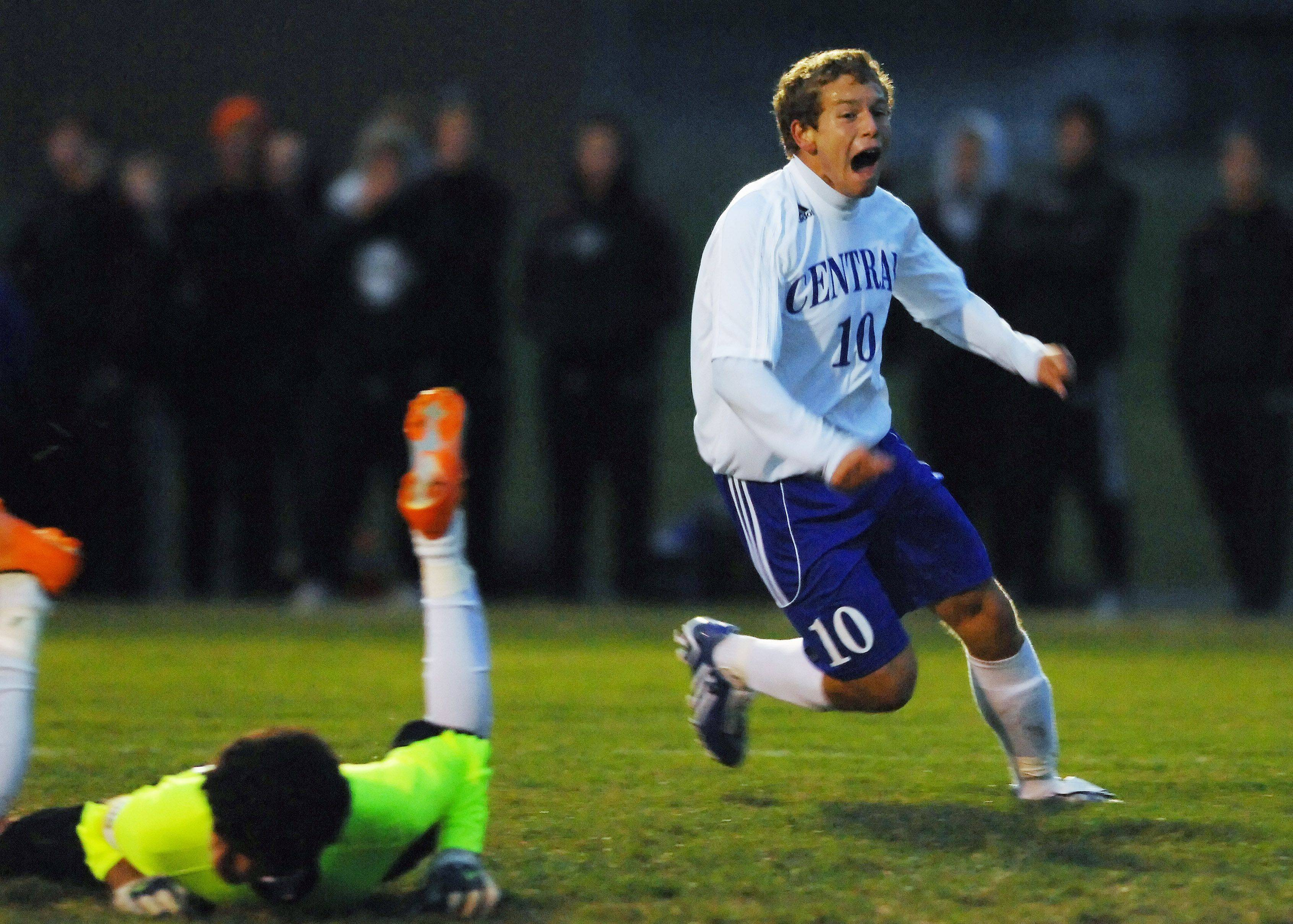 Burlington Central's Chris Gousios yells as his shot hits the back of the net and Marengo goalkeeper Sergio Orozco lays on the ground in the Hampshire regional game Tuesday. It was Gousios' first of three goals.
