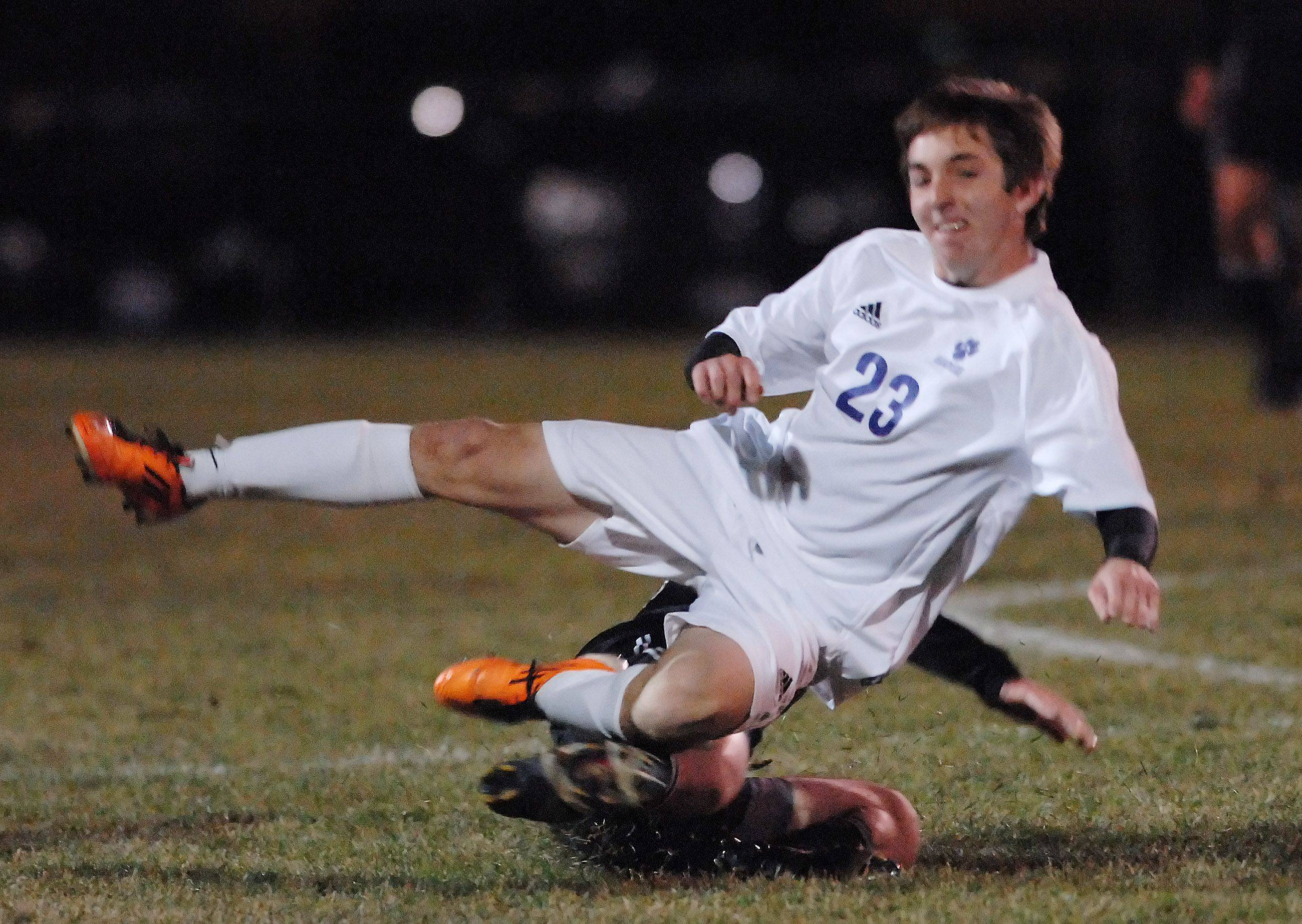 Hampshire's Zack Suthers is taken down by Prairie Ridge's Sam Liscovitz in the Hampshire regional game Tuesday.