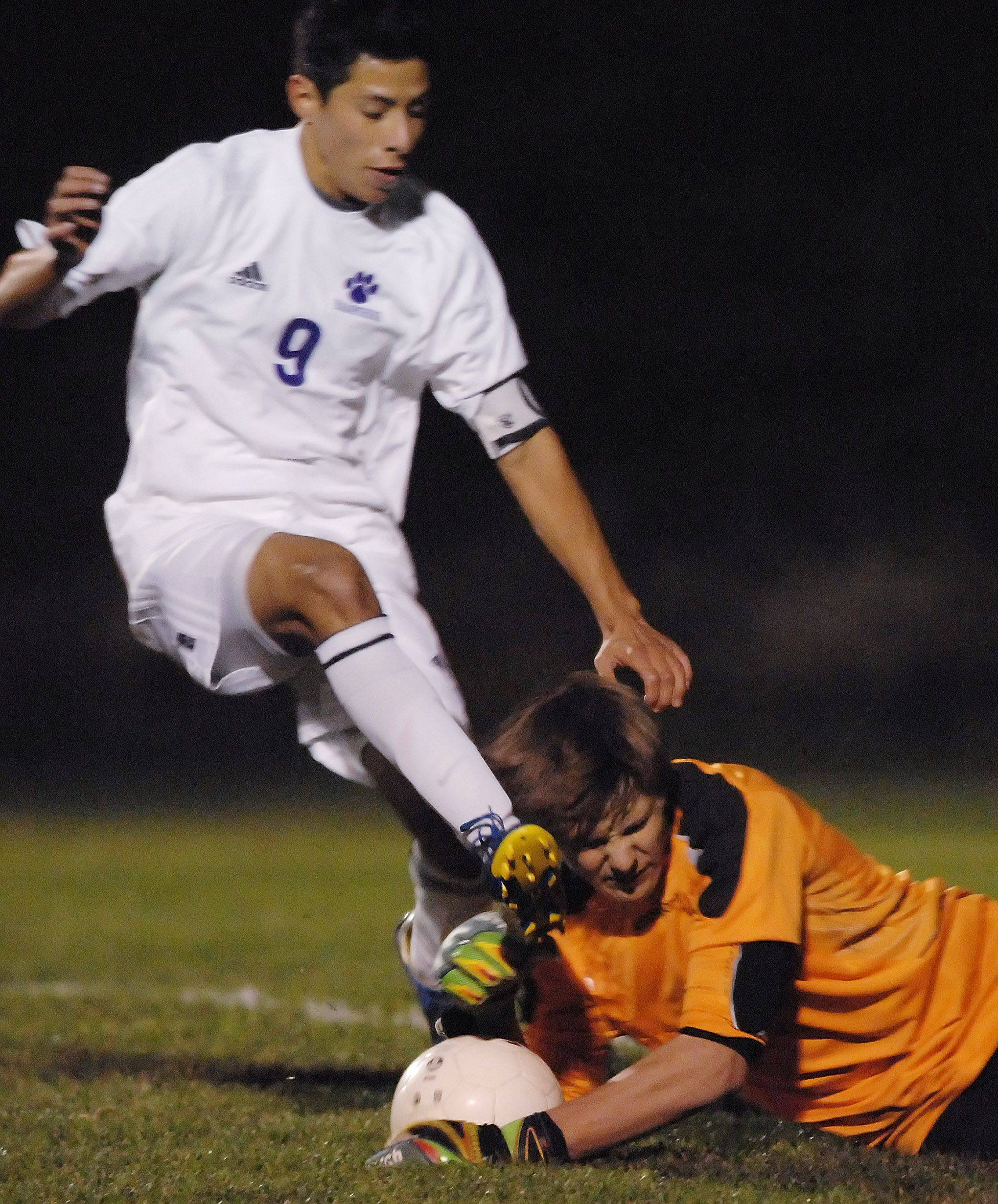 Prairie Ridge goalie Brandon Barnes gets kicked in the head by Hampshire's Ismael Morales as they both go for the ball in the box in the Hampshire regional game Tuesday.
