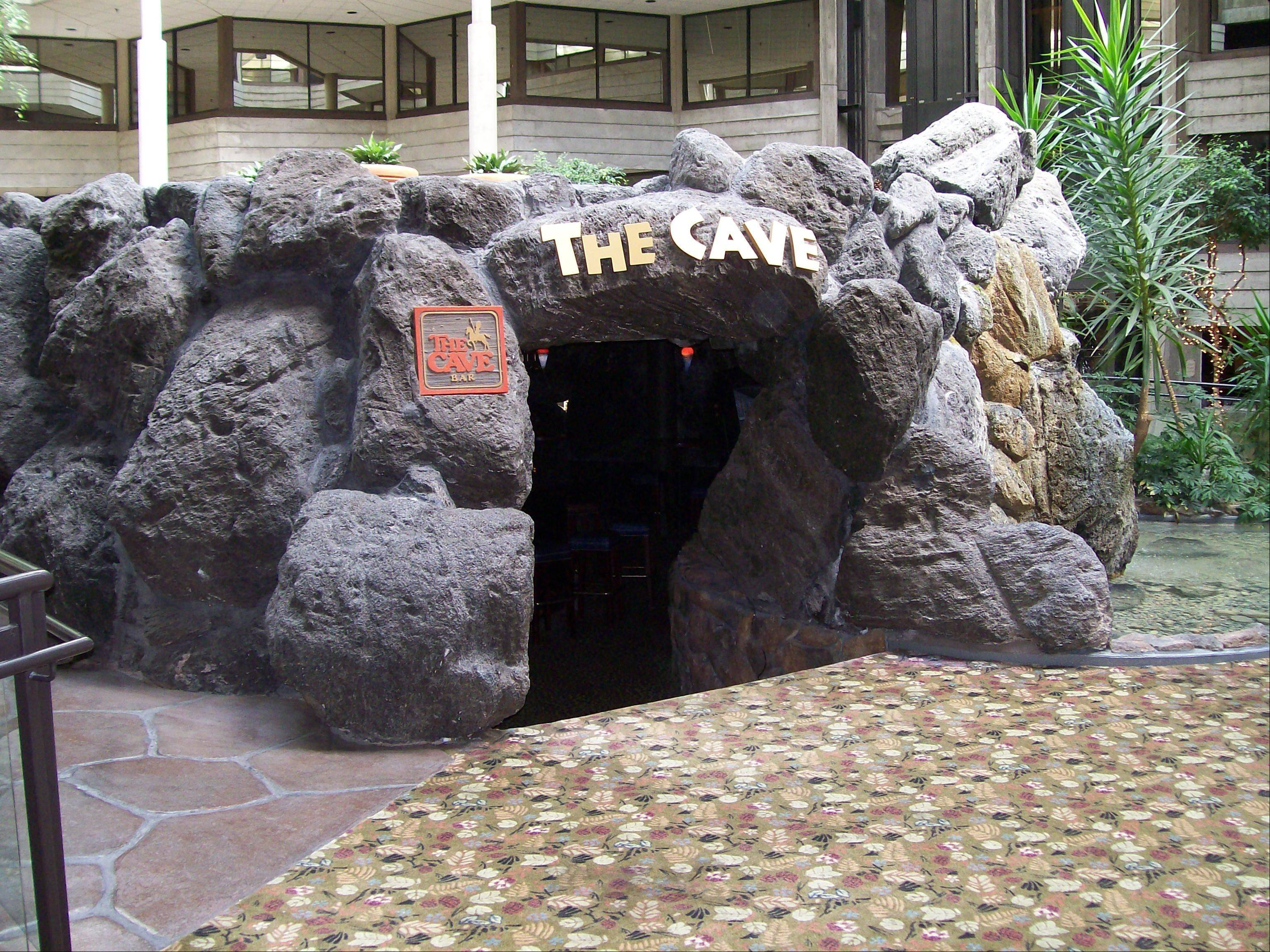Enter the Cave Bar's rock entrance in the atrium of Bloomingdale's Hilton.