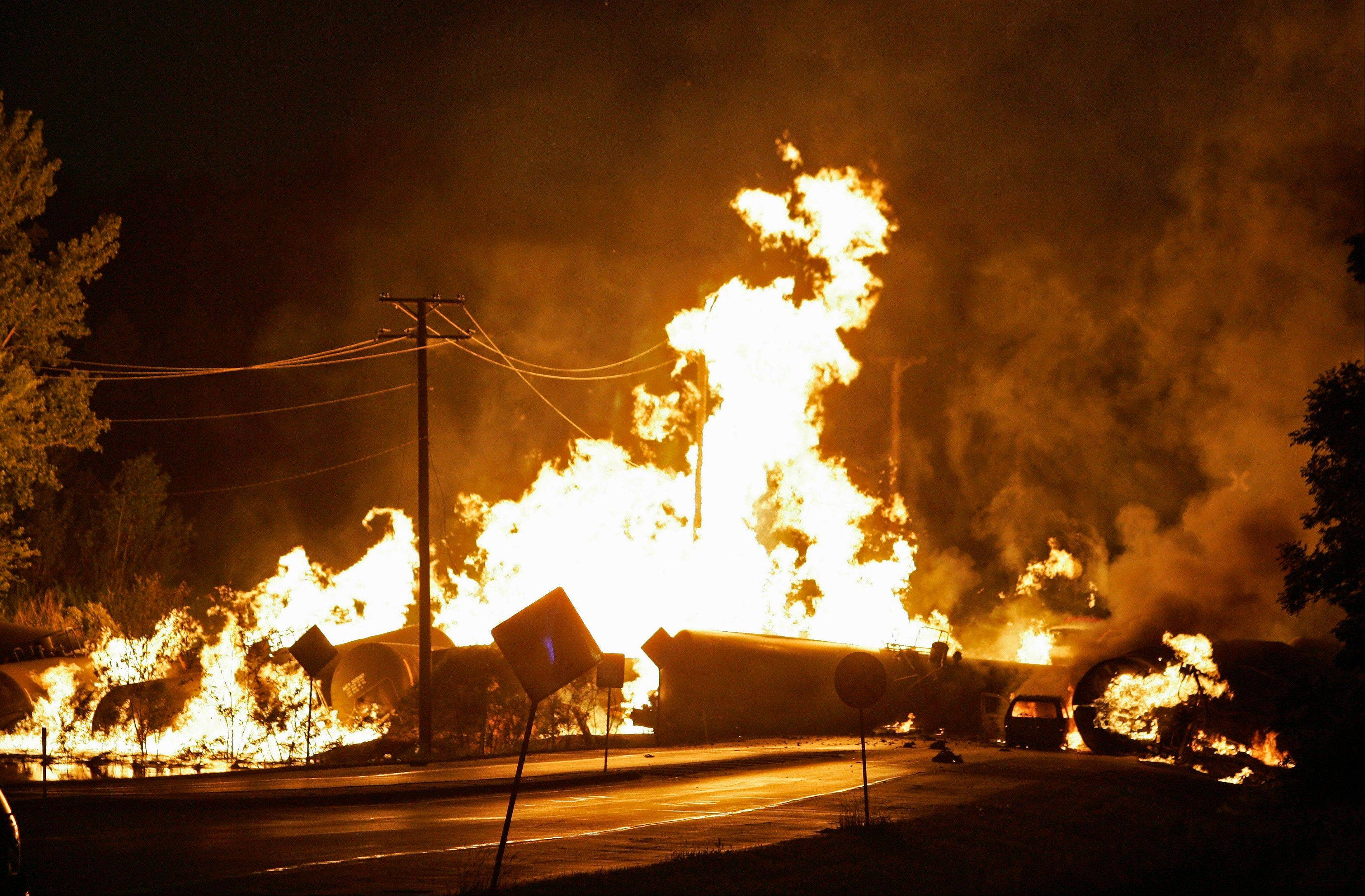 Flames engulf rail cars loaded with thousands of gallons of ethanol after a July 20, 2009, derailment in Cherry Valley, Ill.