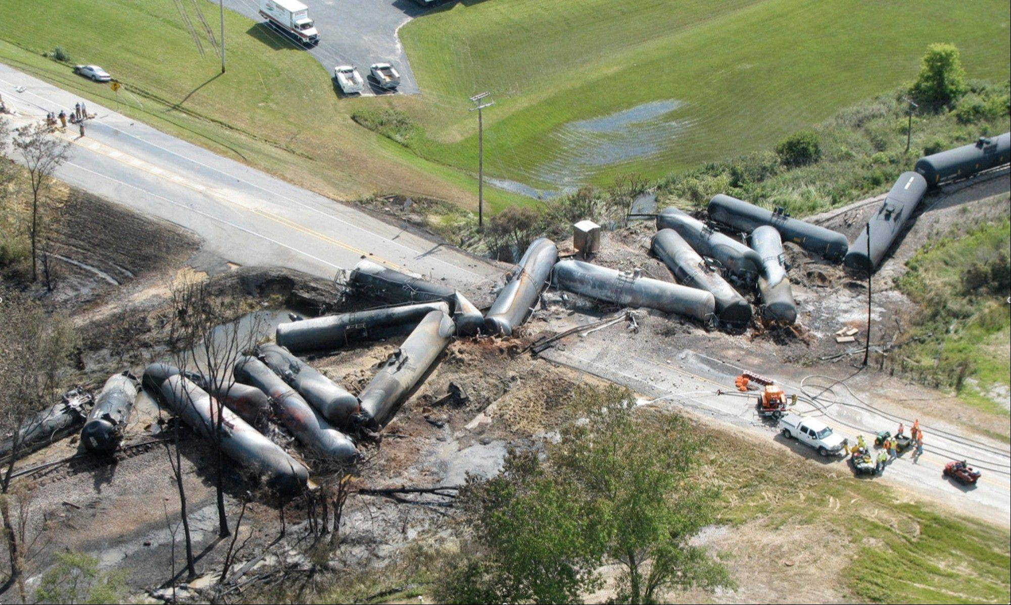 This June 20, 2009, aerial photo provided by the National Transportation Safety Board shows the aftermath of a Canadian National Railway freight train derailment in Cherry Valley, Ill. Rail cars loaded with thousands of gallons of highly flammable ethanol exploded in flames the day before from the derailment.