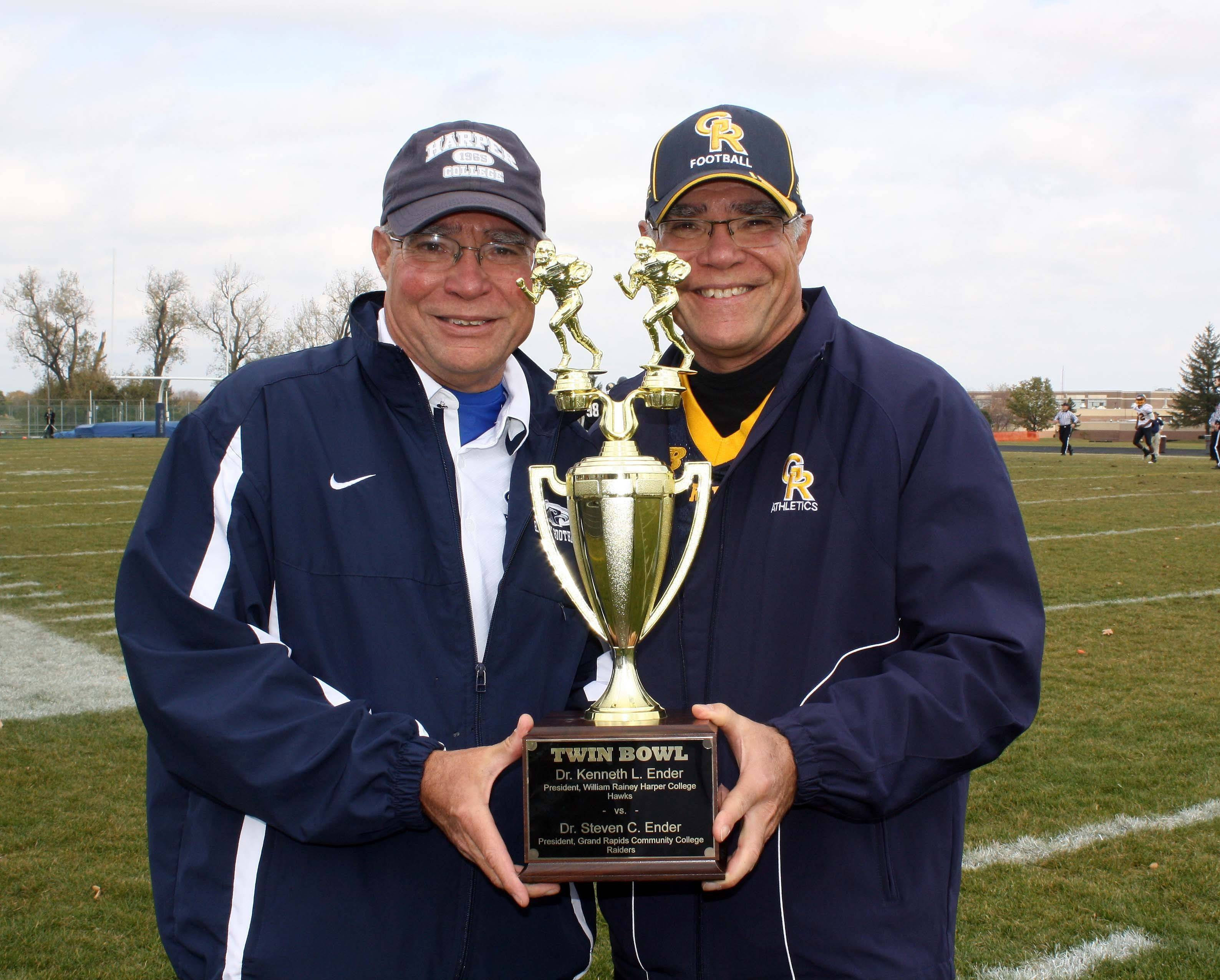 Kenneth Ender, left, and Steven Ender, pose with the Twin Bowl trophy at the 2010 game, hosted by Harper College.