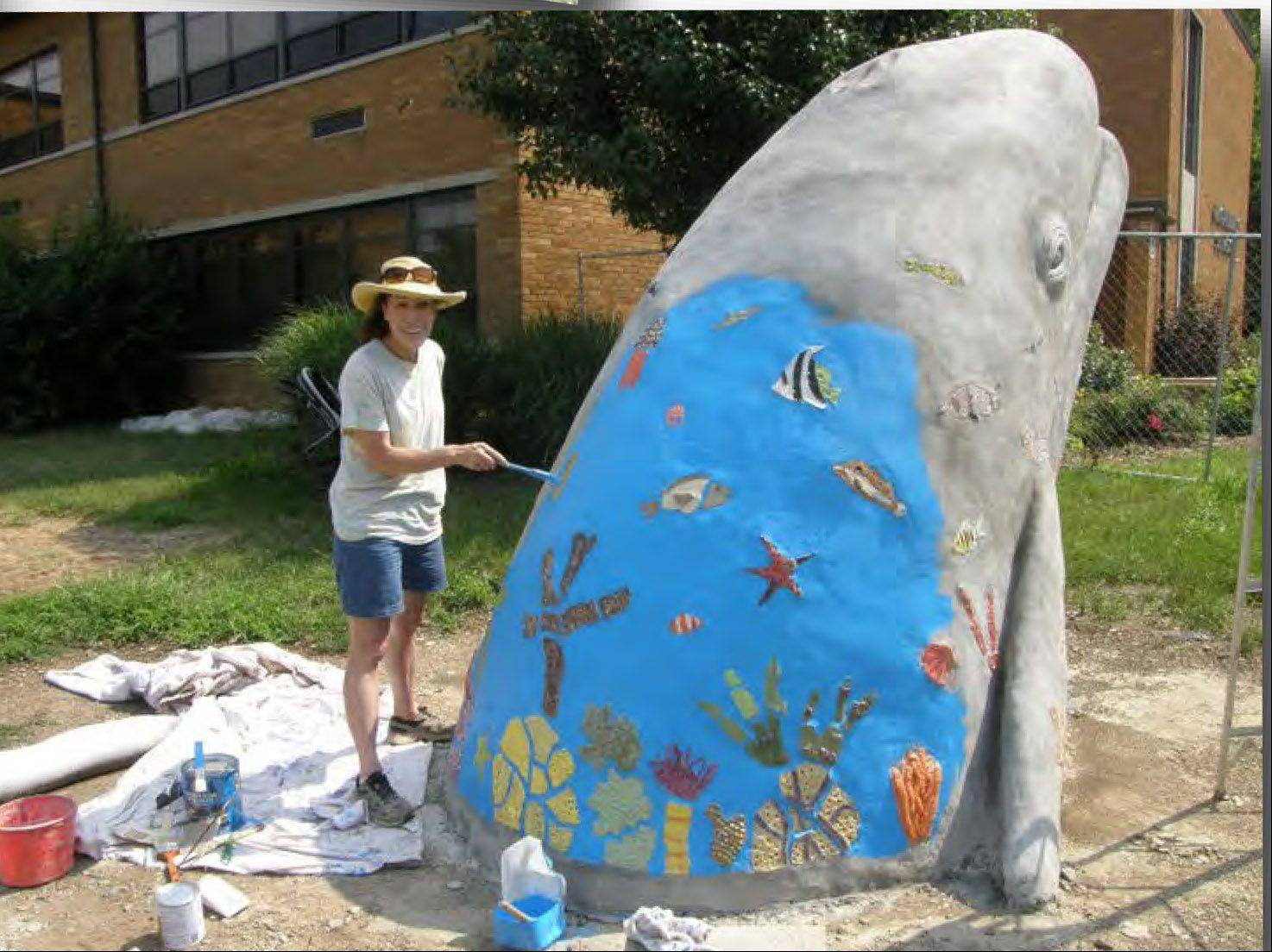 Artist Victoria Fuller incorporated several fish and underwater-themed tiles, made by students, into her whale sculpture outside Naperville's Highlands Elementary School.