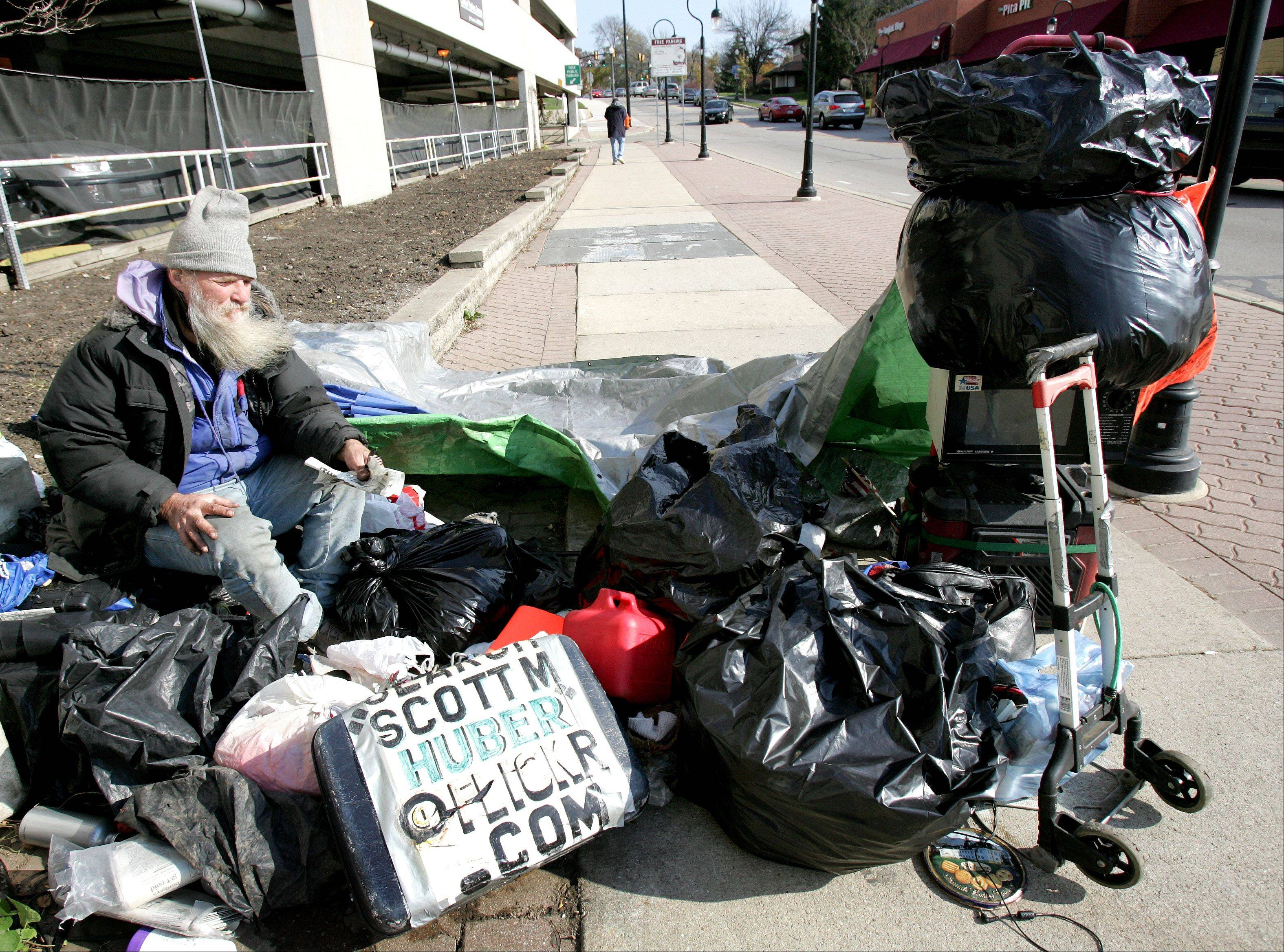Naperville squatter Scott Huber sits at his Chicago Avenue encampment in 2009.
