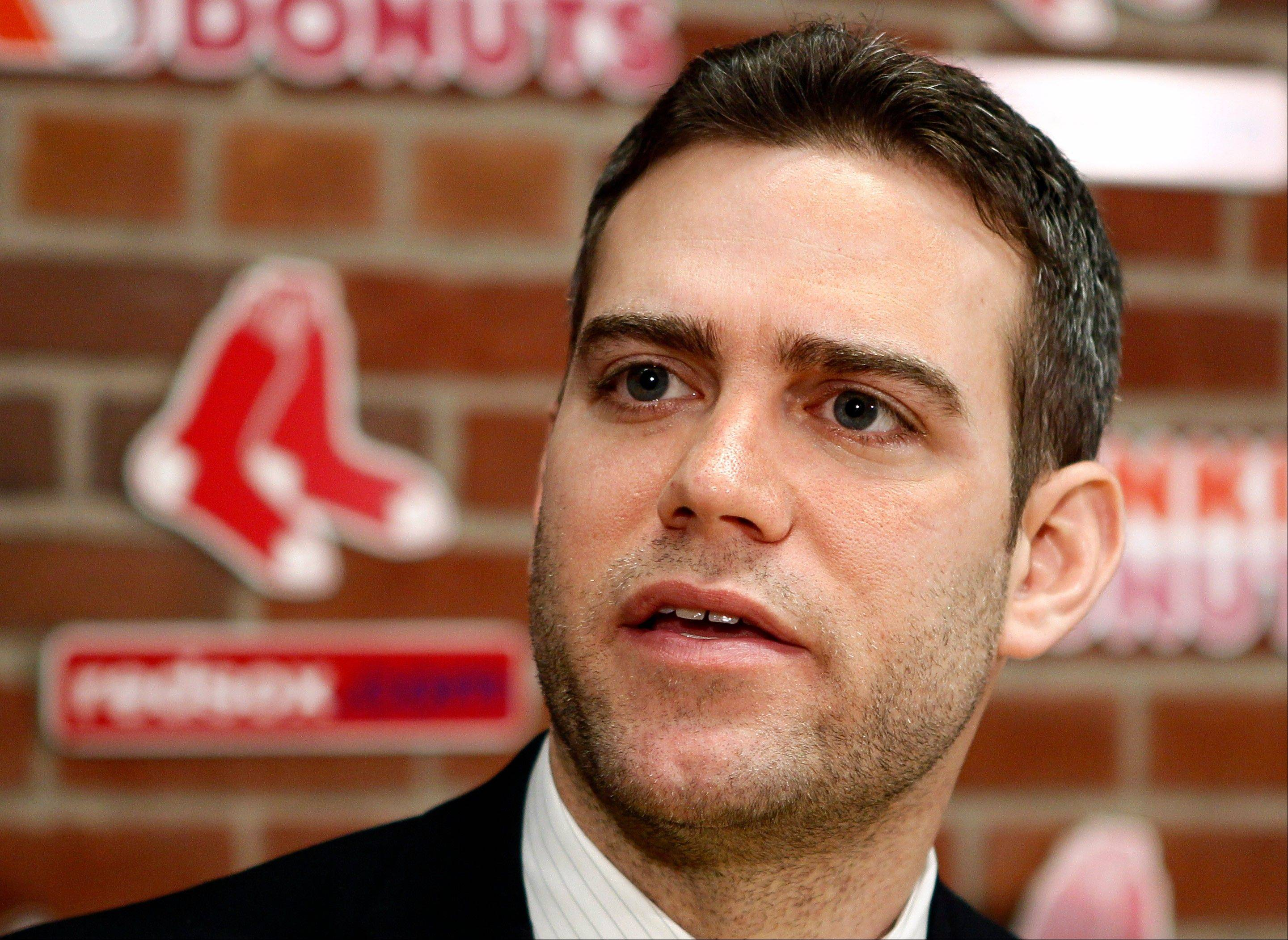 The Cubs and Red Sox issued a statement Friday night saying Theo Epstein has resigned from Boston and is the Cubs' new president of baseball operations.