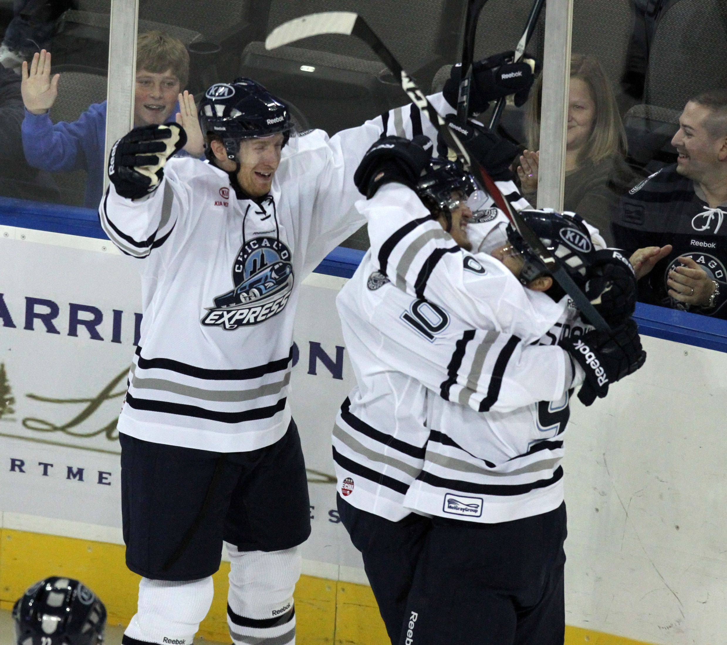 Chicago Express forward Kyle Lehman, right, celebrates a goal with teammates at 19:22 in the first period in home opener against Kalamazoo Wings at the Sears Centre in Hoffman Estates on Saturday, October 22nd.