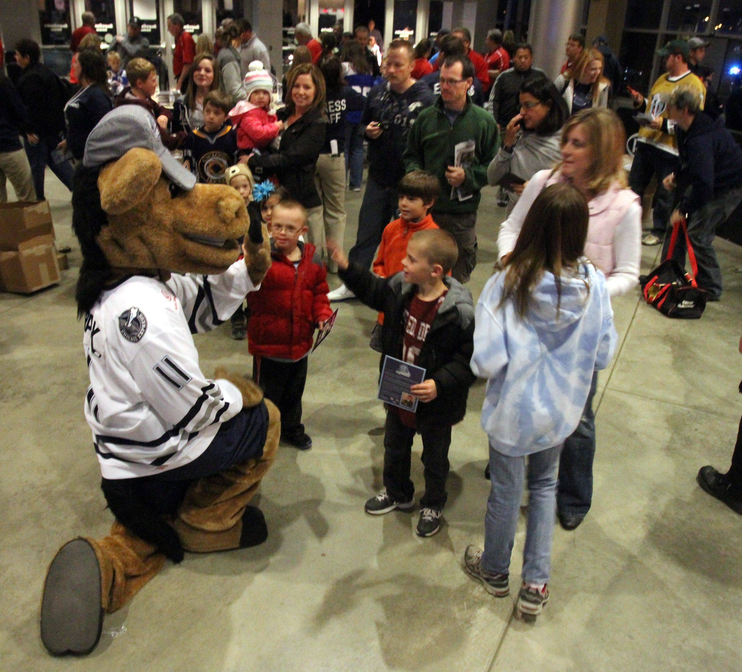 Chicago Express mascot Trax, named by Kathy Hare in a contest, greets fans for the home opener at the Sears Centre.