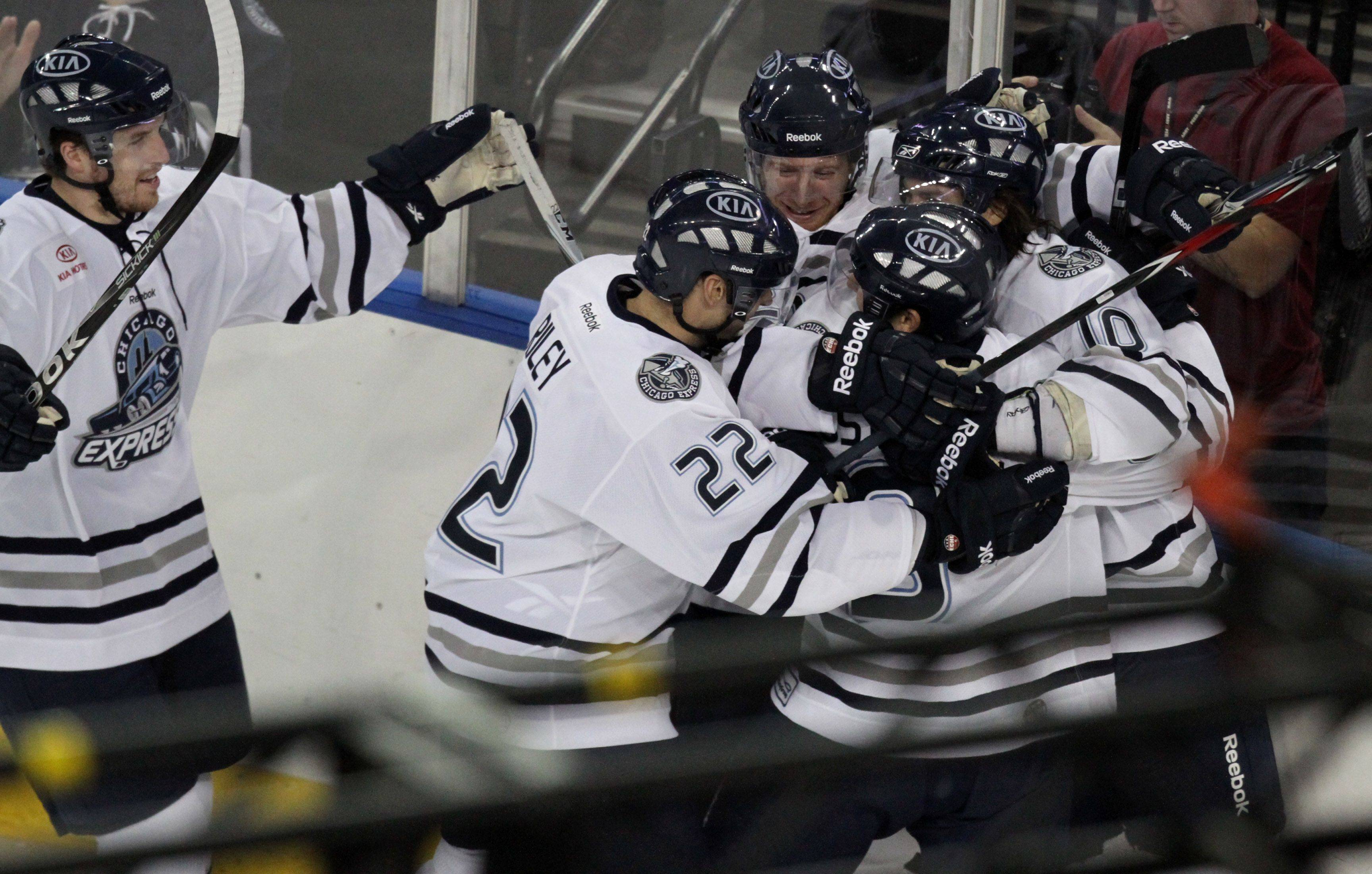 Chicago Express forward Kyle Lehman, right center, is mobbed by teammates after scoring a goal at 19:22 in the first period in home opener against Kalamazoo Wings at the Sears Centre in Hoffman Estates on Saturday, October 22nd.