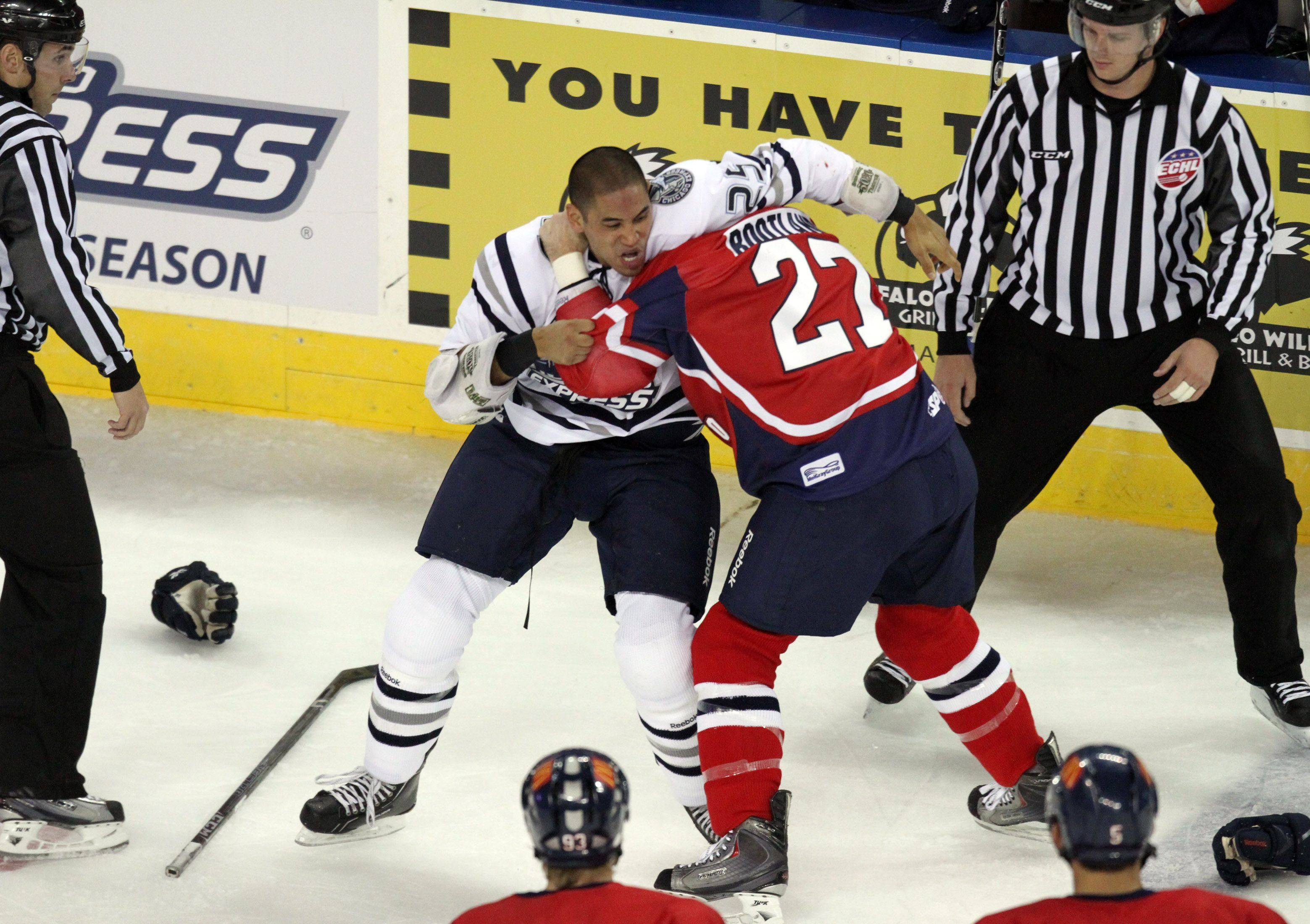 A lengthy fight continued between Chicago Express forward Bobby Robins, left, and Kalamazoo Wings right wing Darryl Bootland after the two fell to the ice and got back up at the Sears Centre in Hoffman Estates on Saturday, October 22nd.