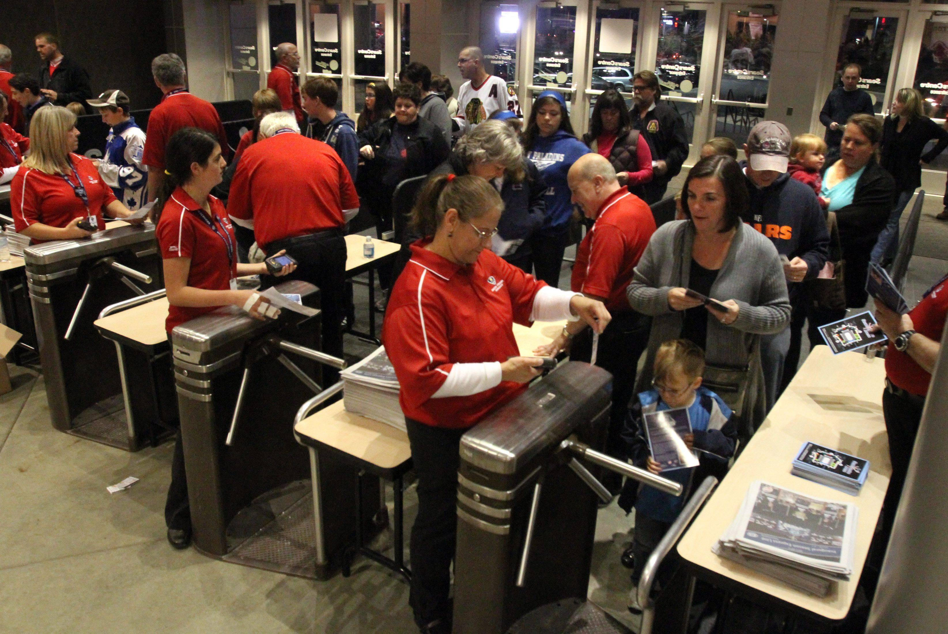 Patrons enter the Sears Centre in Hoffman Estates for the Chicago Express home opener against Kalamazoo Wings on Saturday, October 22nd.