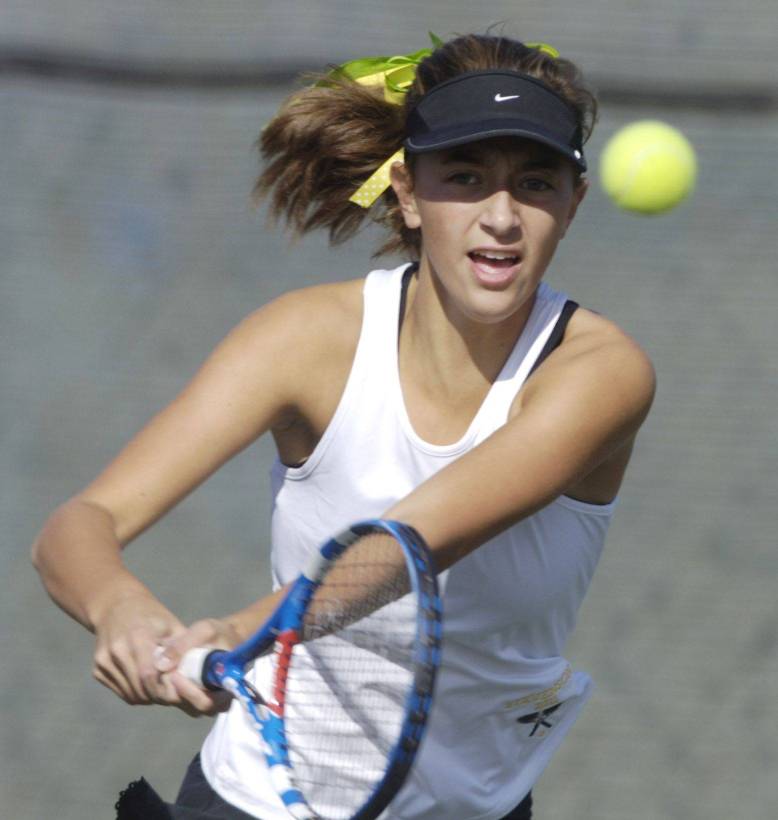 Stevenson doubles player Alexxis Kiven returns a ball at the net during Saturday's girls state tennis semifinal against Hinsdale Central.