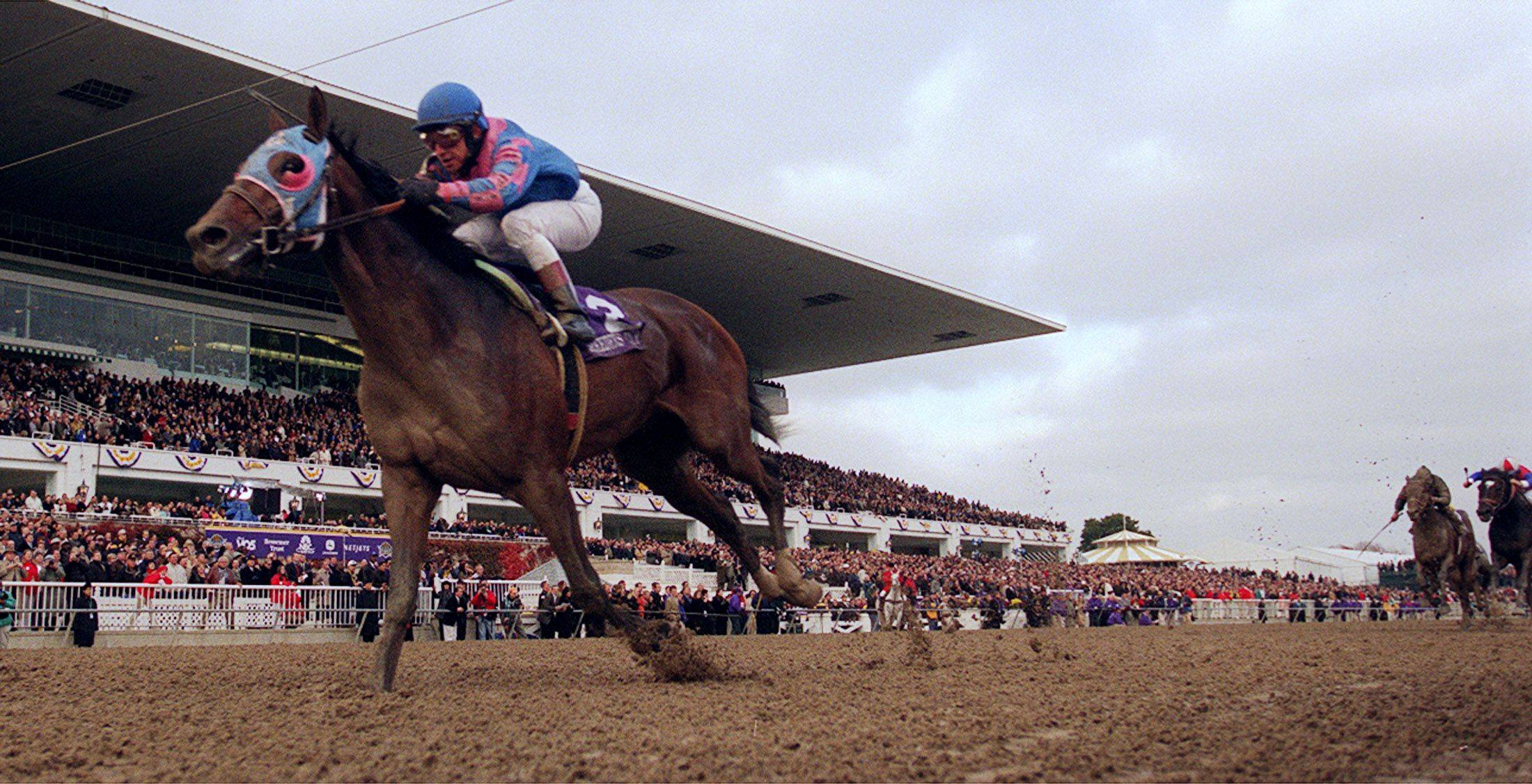 Volponi and jockey Jose Santos cross the finish to win the Breeders Cup Classic in 2002 at Arlington Park. Horse racing advocates say Gov. Pat Quinn made the wrong choice when he trimmed slots at race tracks but kept five casinos in his gambling alternative.