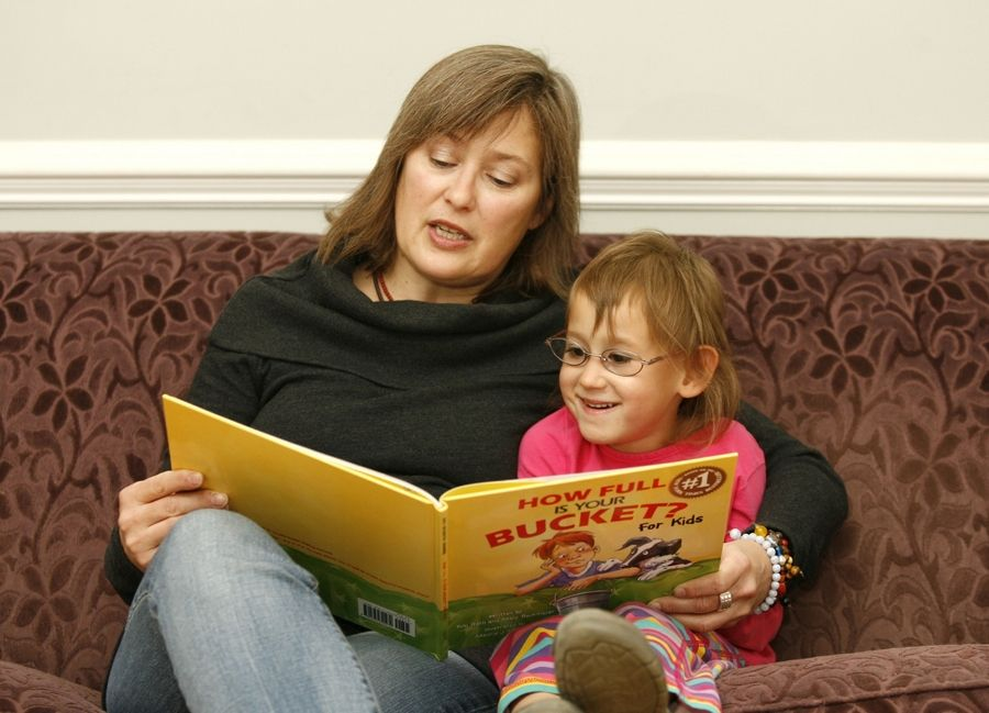Janet Wagner reads to her 5-year-old daughter Sasha. Early intervention helps kids with an FASD, but the challenges are lifelong.