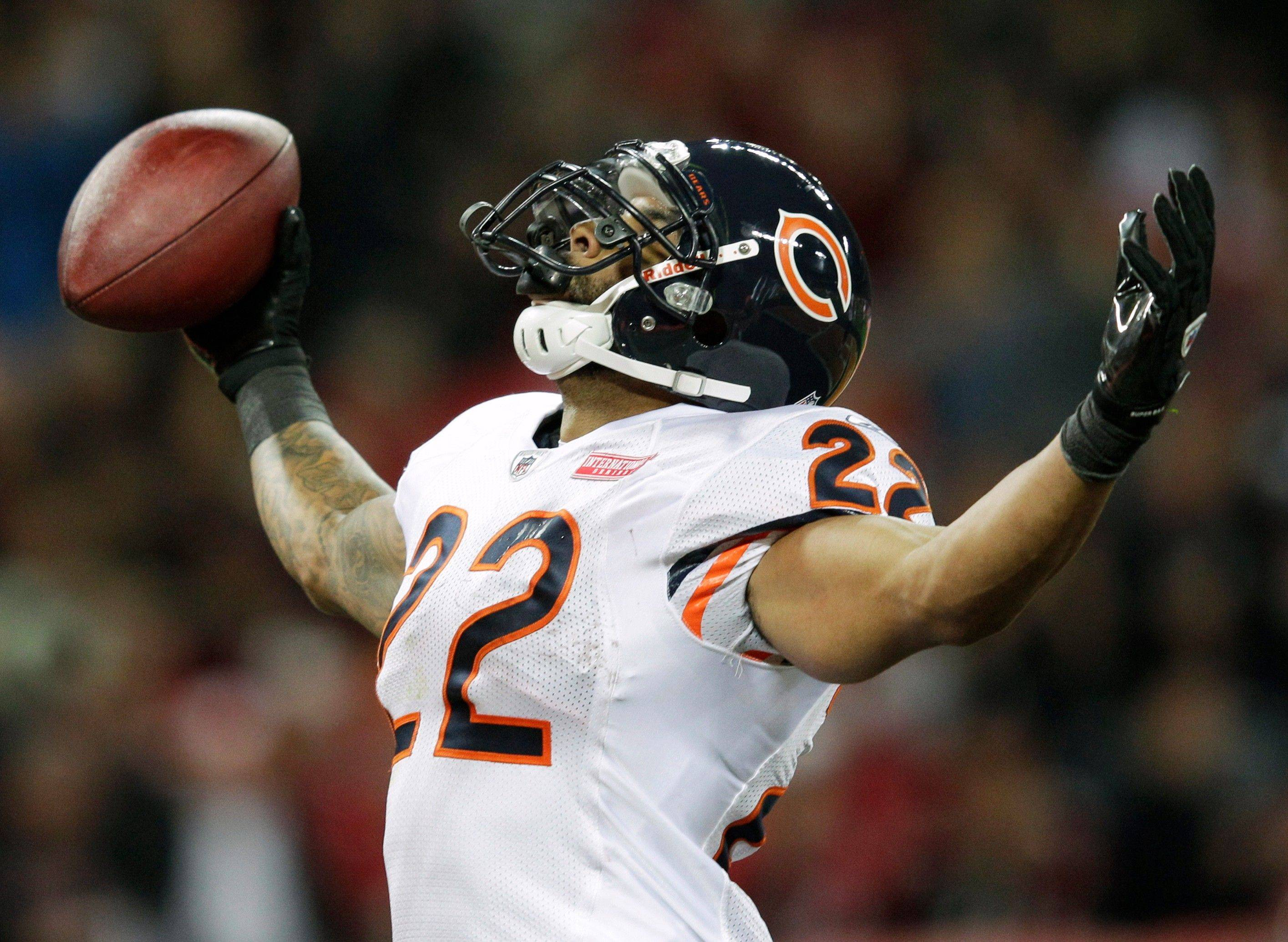 Chicago Bears running back Matt Forte celebrates his 32-yard touchdown during the first half of an NFL football game Sunday, Oct. 23, at Wembley Stadium in London.