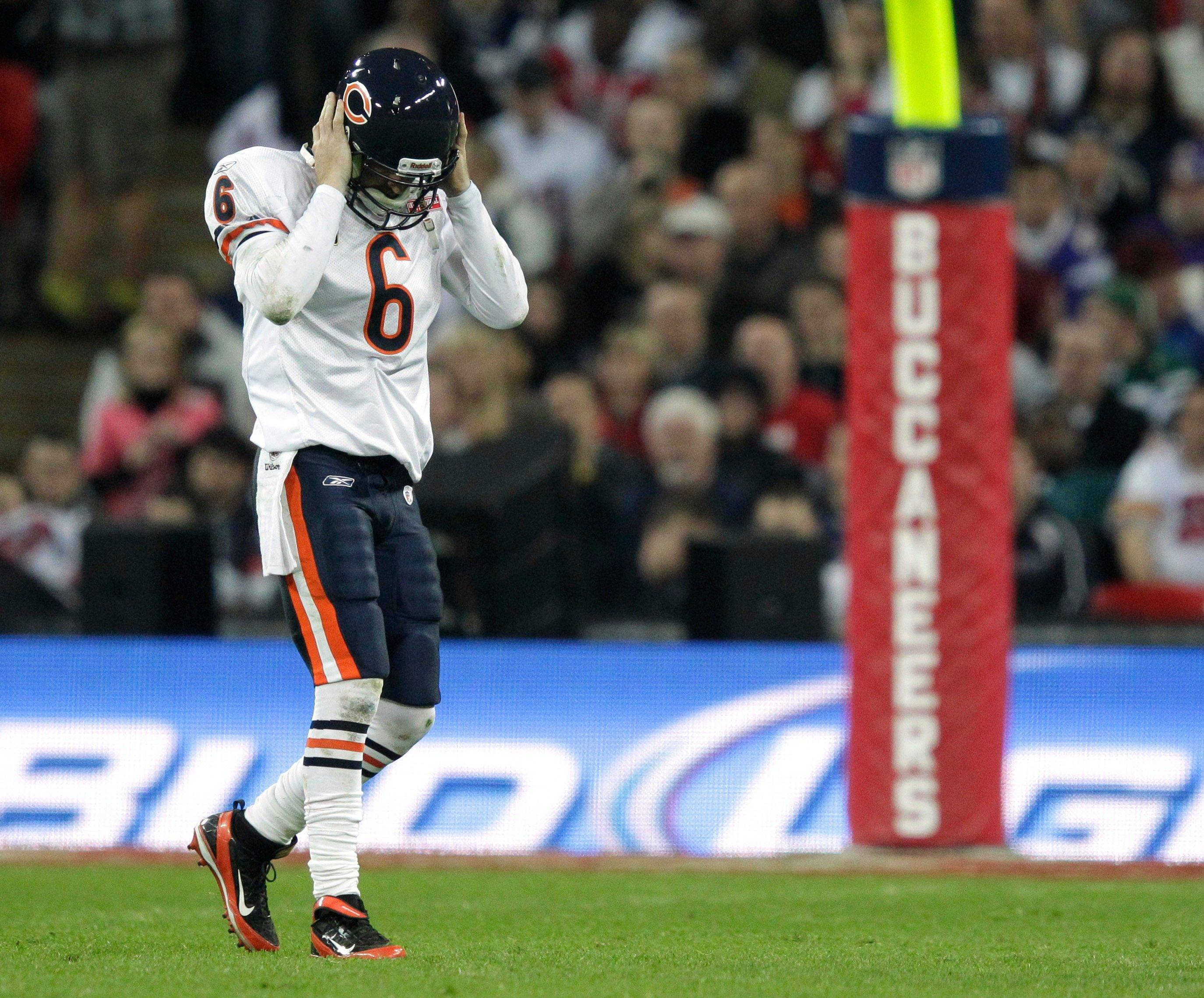 Chicago Bears quarterback Jay Cutler holds his helmet after throwing a pass intercepted by Tampa Bay Buccaneers free safety Corey Lynch during the second half.