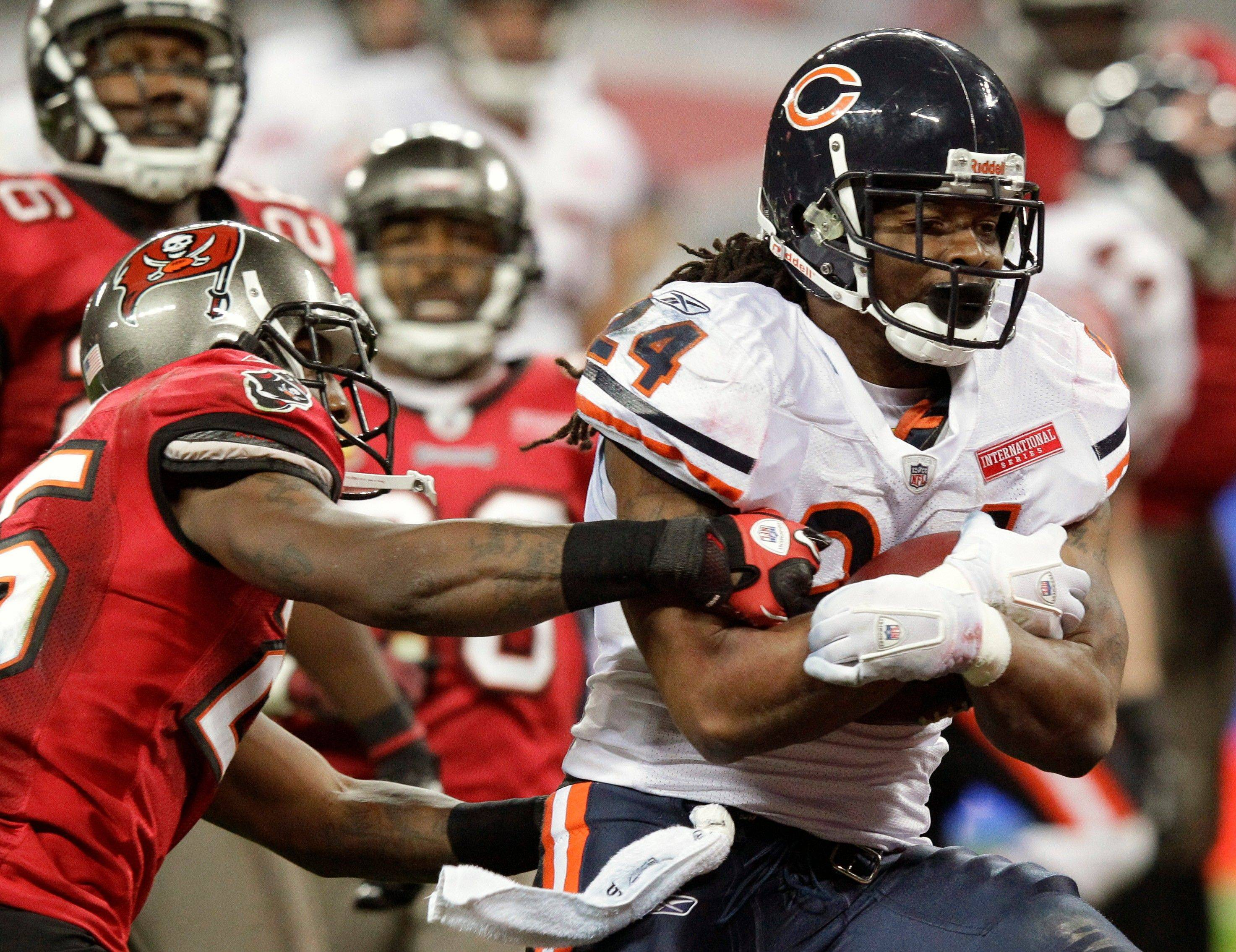 Chicago Bears running back Marion Barber runs past Tampa Bay Buccaneers cornerback Aqib Talib to score a 12-yard touchdown during the second half.