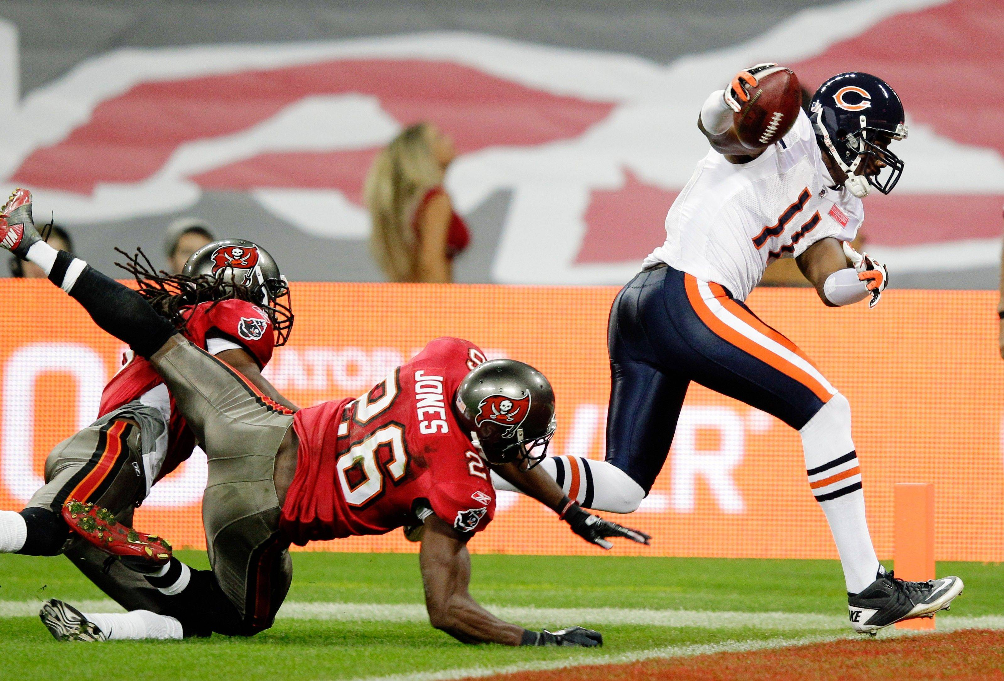 Tampa Bay Buccaneers safety Sean Jones misses a tackle on Chicago Bears wide receiver Roy Williams as he scores on a 25-yard touchdown pass during the first half.
