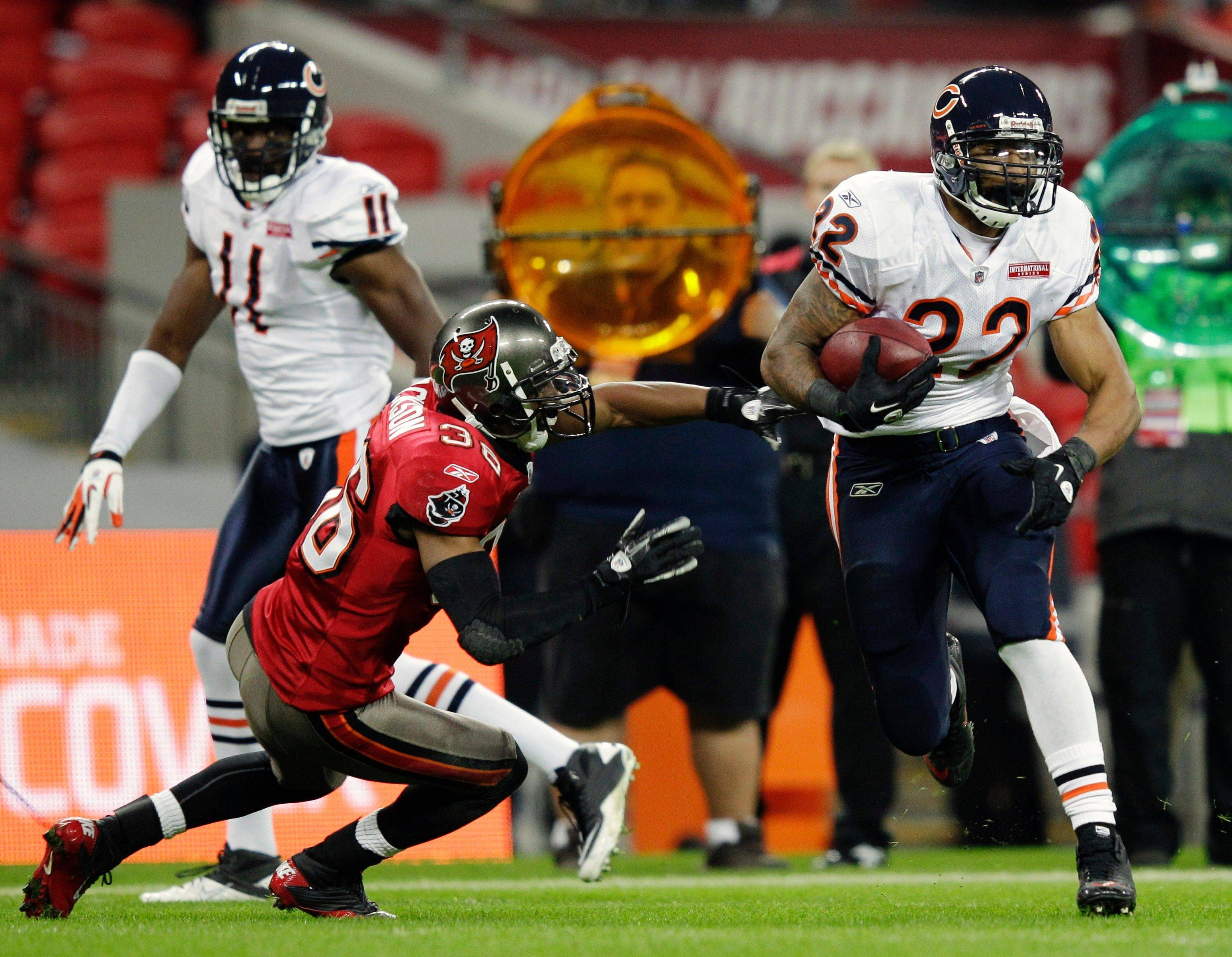 Tampa Bay Buccaneers defensive back Tanard Jackson cannot stop Chicago Bears running back Matt Forte on a run for a 32-yard touchdown during the first half.