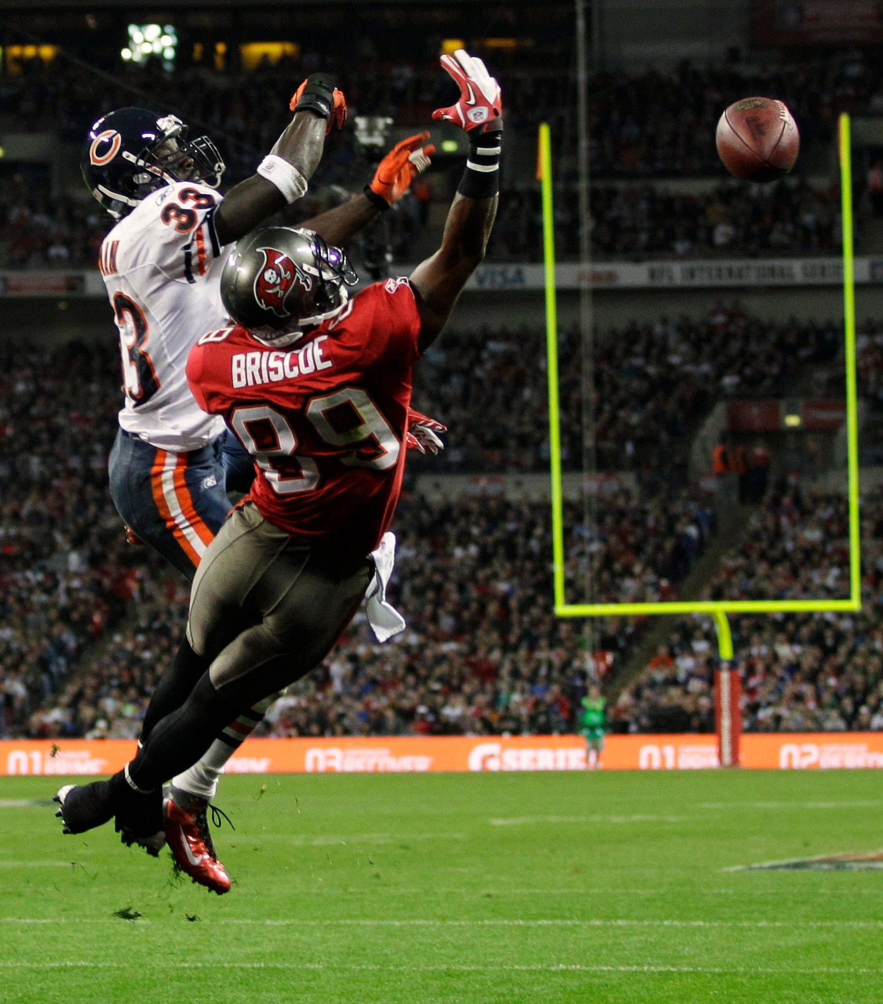 Chicago Bears cornerback Charles Tillman defends as Tampa Bay Buccaneers wide receiver Dezmon Briscoe cannot catch intended for him during the first half.