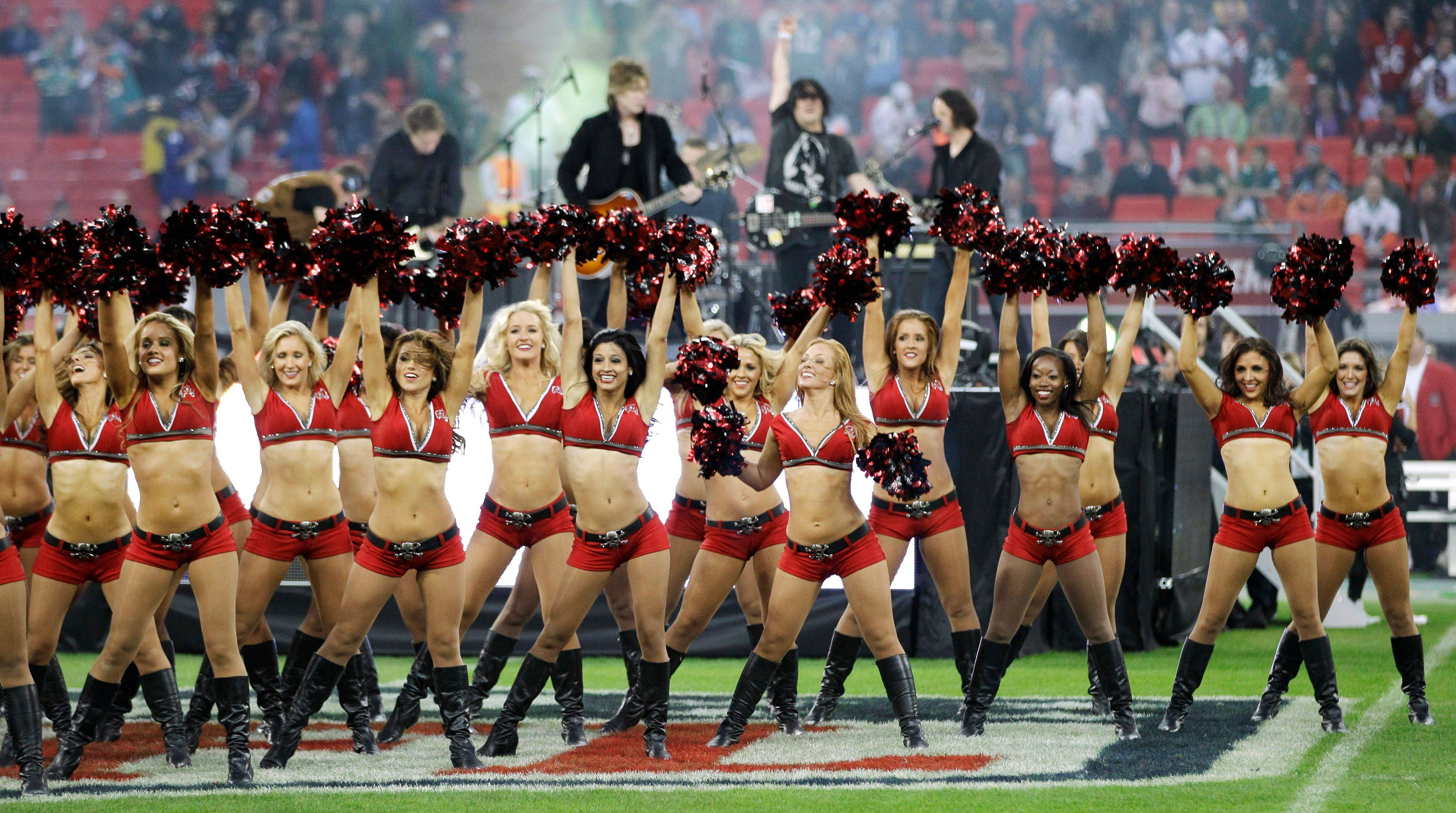 Tampa Bay Buccaneers cheerleaders perform in front of the Goo Good Dolls during the first half of an NFL football game between the Tampa Bay Buccaneers and Chicago Bears at Wembley Stadium in London.