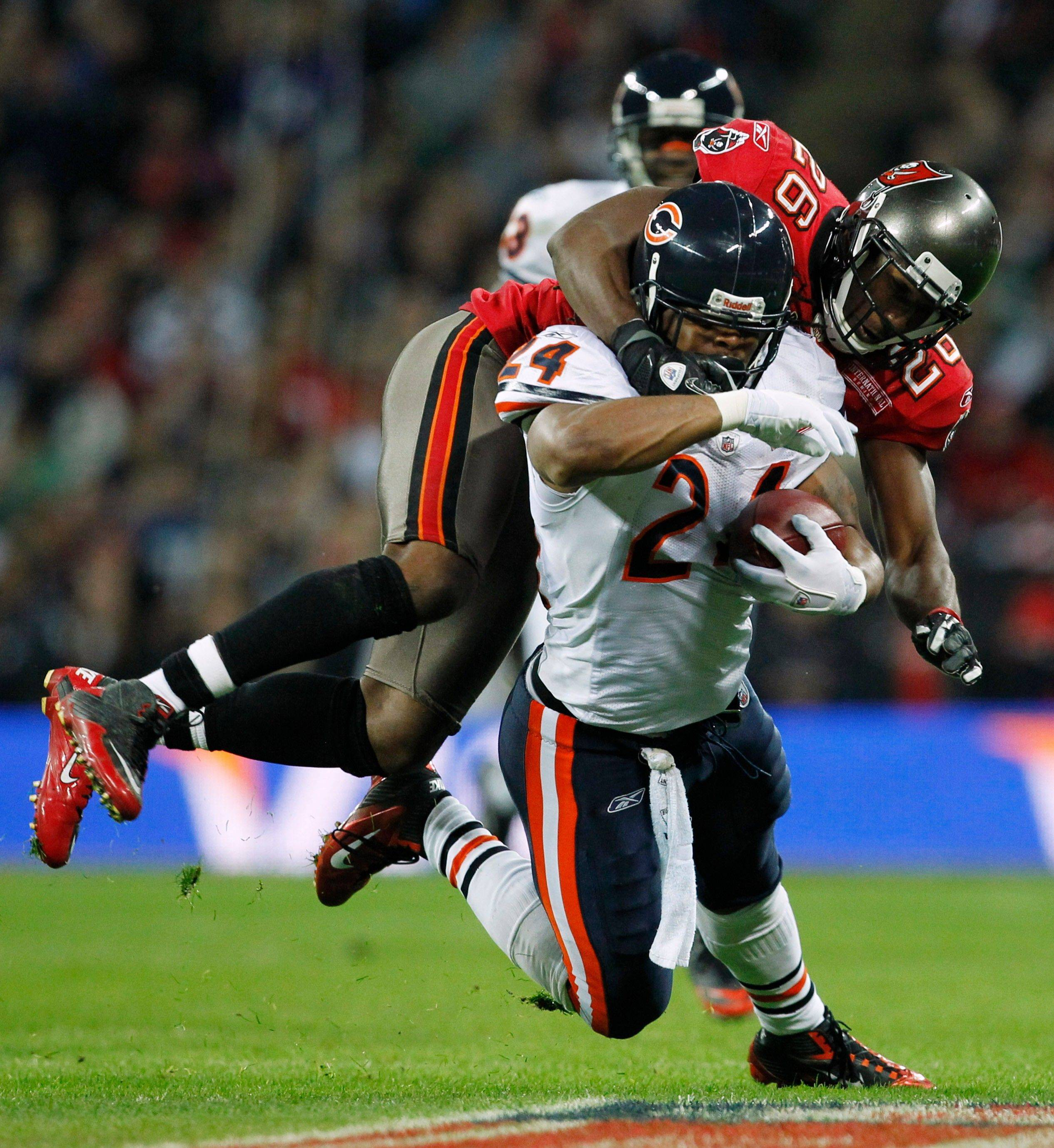 Chicago Bears running back Marion Barber is tackled by Tampa Bay Buccaneers safety Sean Jones during the first half.