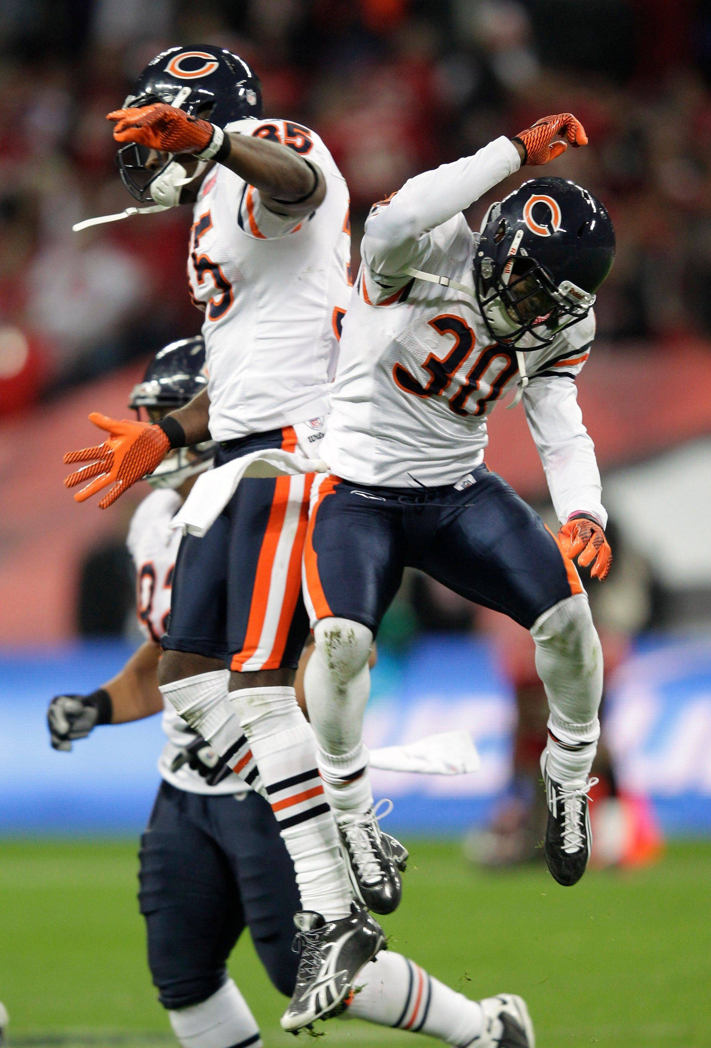 Chicago Bears defensive back D.J. Moore (30) celebrates catching an interception with teammate Zack Bowman during the second half.