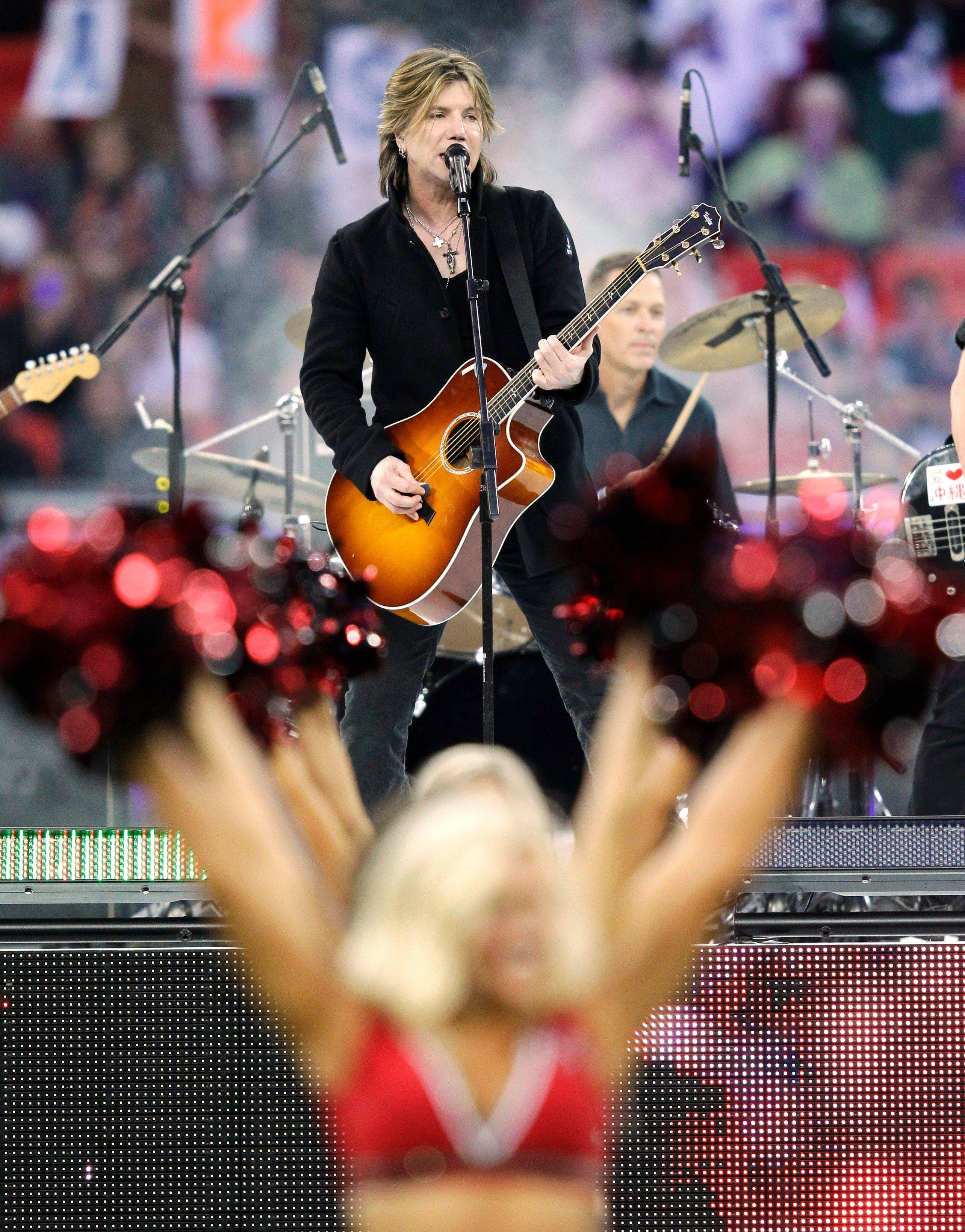 The Goo Goo Dolls perform in front of the Tampa Bay Buccaneers cheerleaders before an NFL football game between the Tampa Bay Buccaneers and Chicago Bears at Wembley Stadium in London.