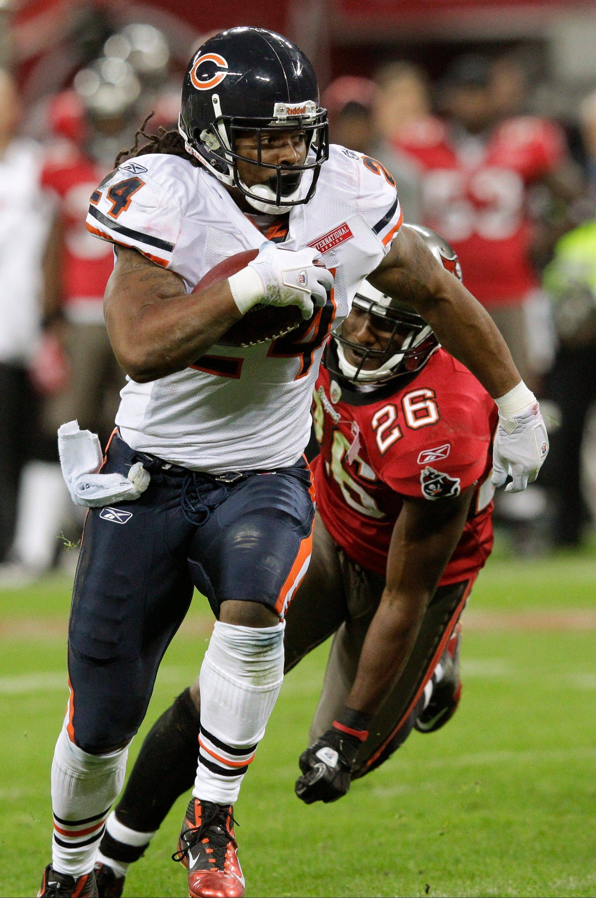 Chicago Bears running back Marion Barber breaks away from Tampa Bay Buccaneers safety Sean Jones to score a 12-yard touchdown during the second half.