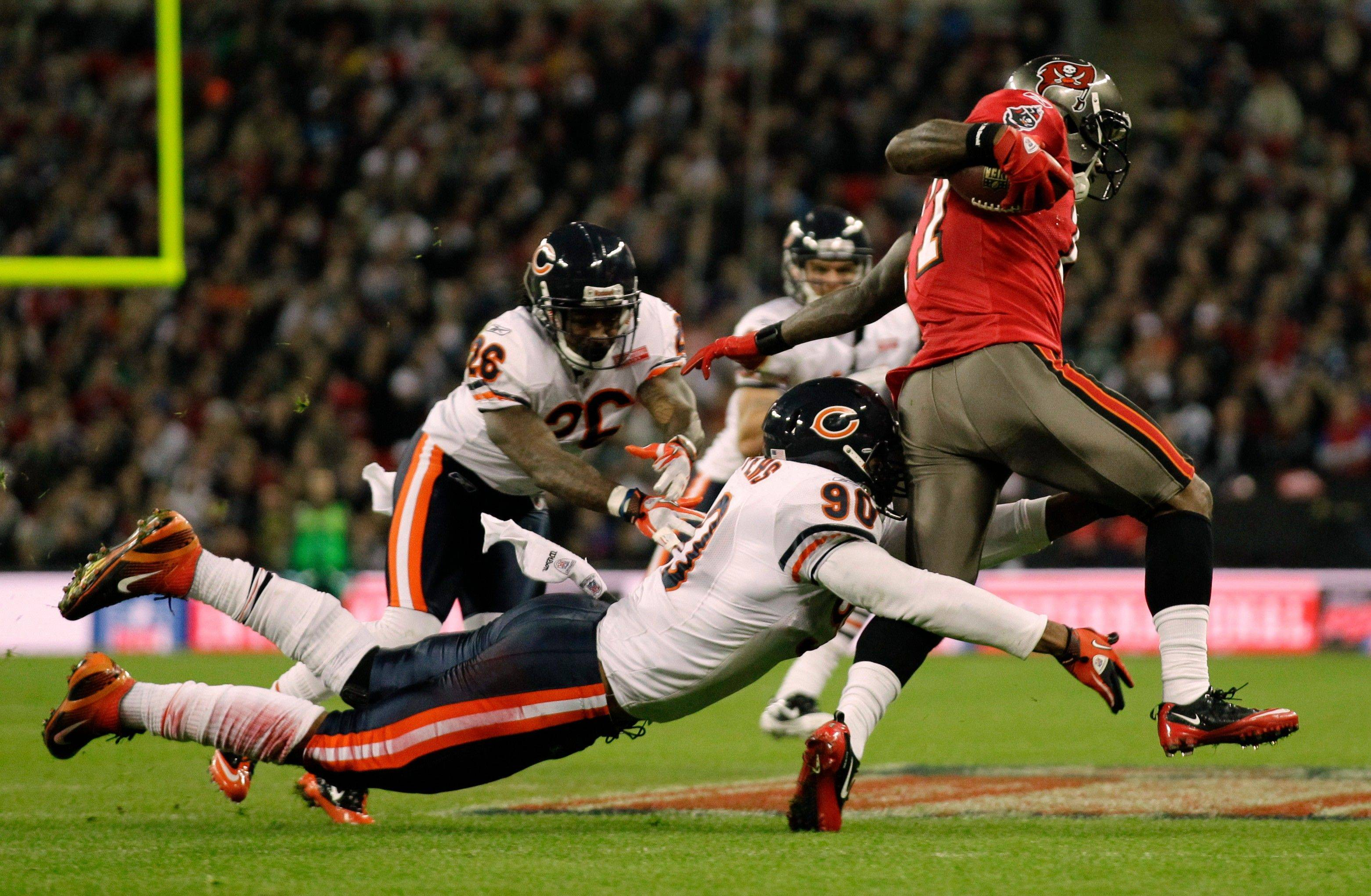 Chicago Bears defensive end Julius Peppers tries to stop Tampa Bay Buccaneers wide receiver Arrelious Benn during the second half.