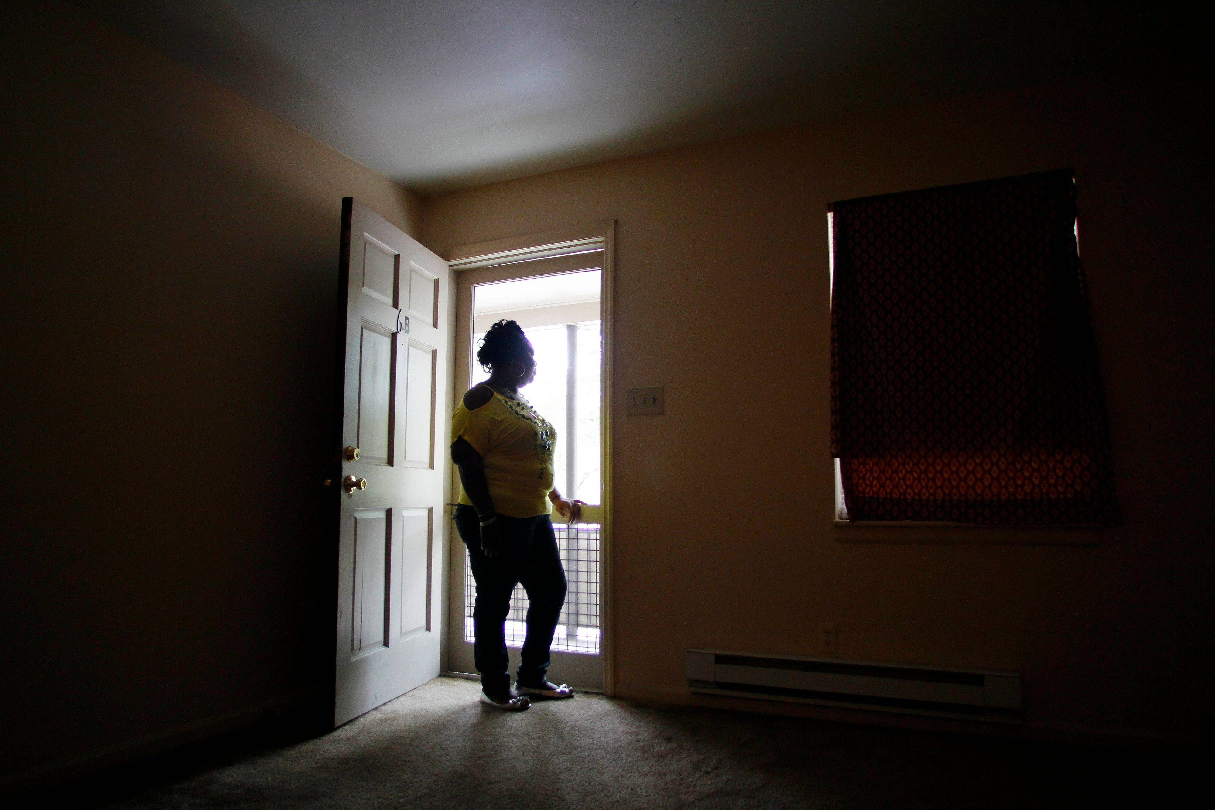 Vickie Webb stands in the doorway of her apartment in Durham, N.C. Webb, 43, lived in the projects in Durham, N.C., for several years before a housing agency helped relocate her and her husband to a better neighborhood.
