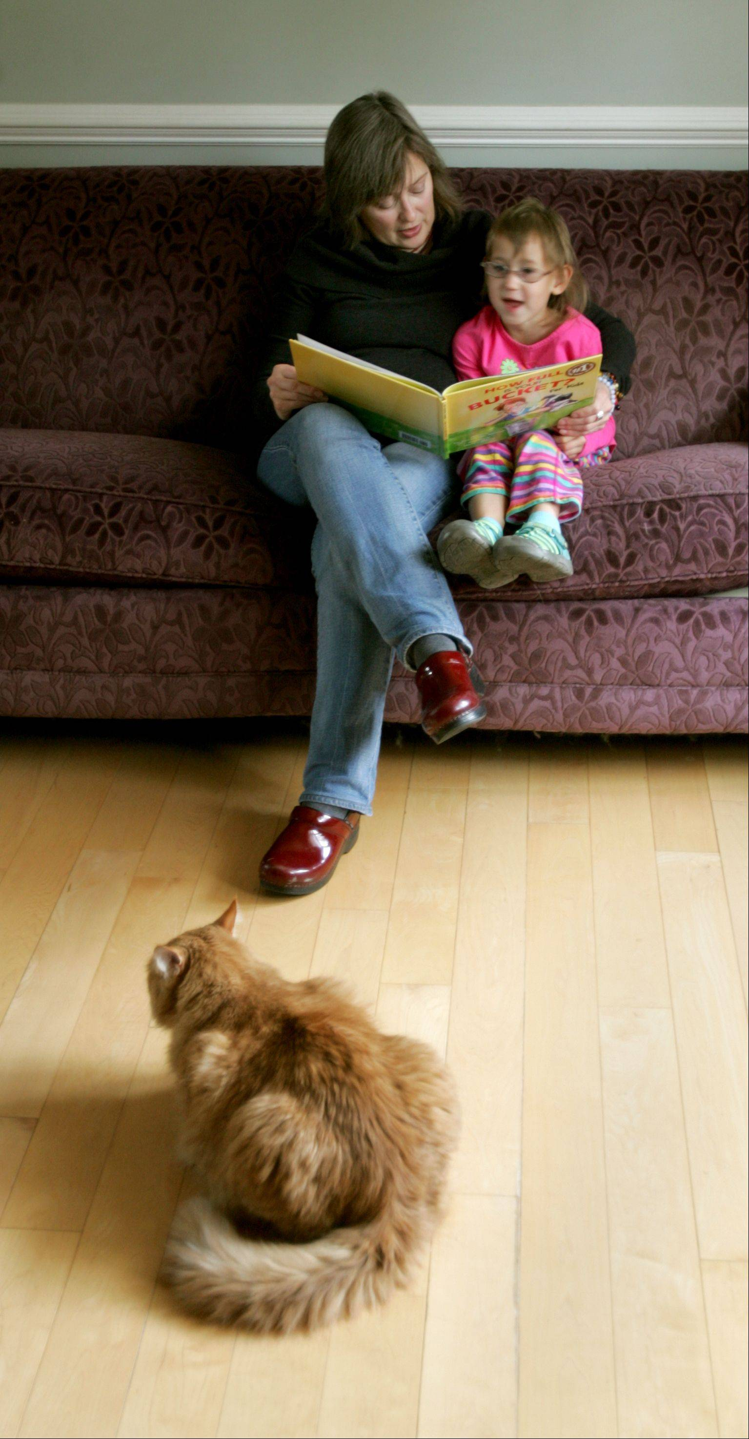 Janet Wagner of Glen Ellyn reads to her 5-year-old daughter Sasha, who was adopted from Russia and has fetal alcohol syndrome.