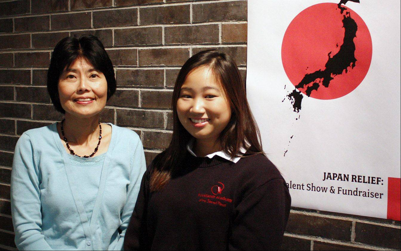 Woodlands Academy of the Sacred Heart college counselor Naomi Ewing and Relief for Japan student leader Catherine Wanandi welcome more donations from the community for their relief efforts.