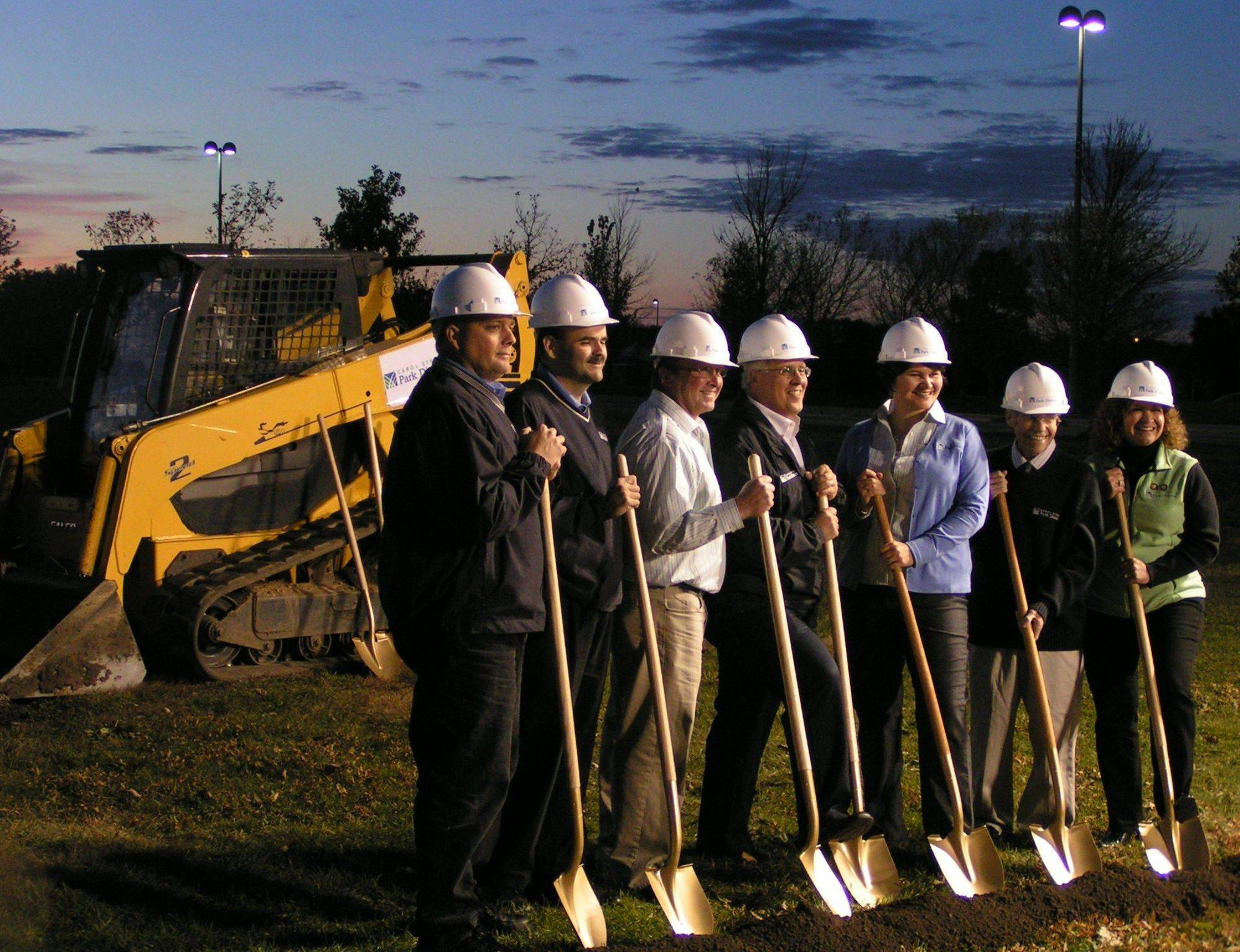 Members of the Carol Stream Park District board of commissioners break ground on a planned $18 million recreation center at the Town Center Monday night.