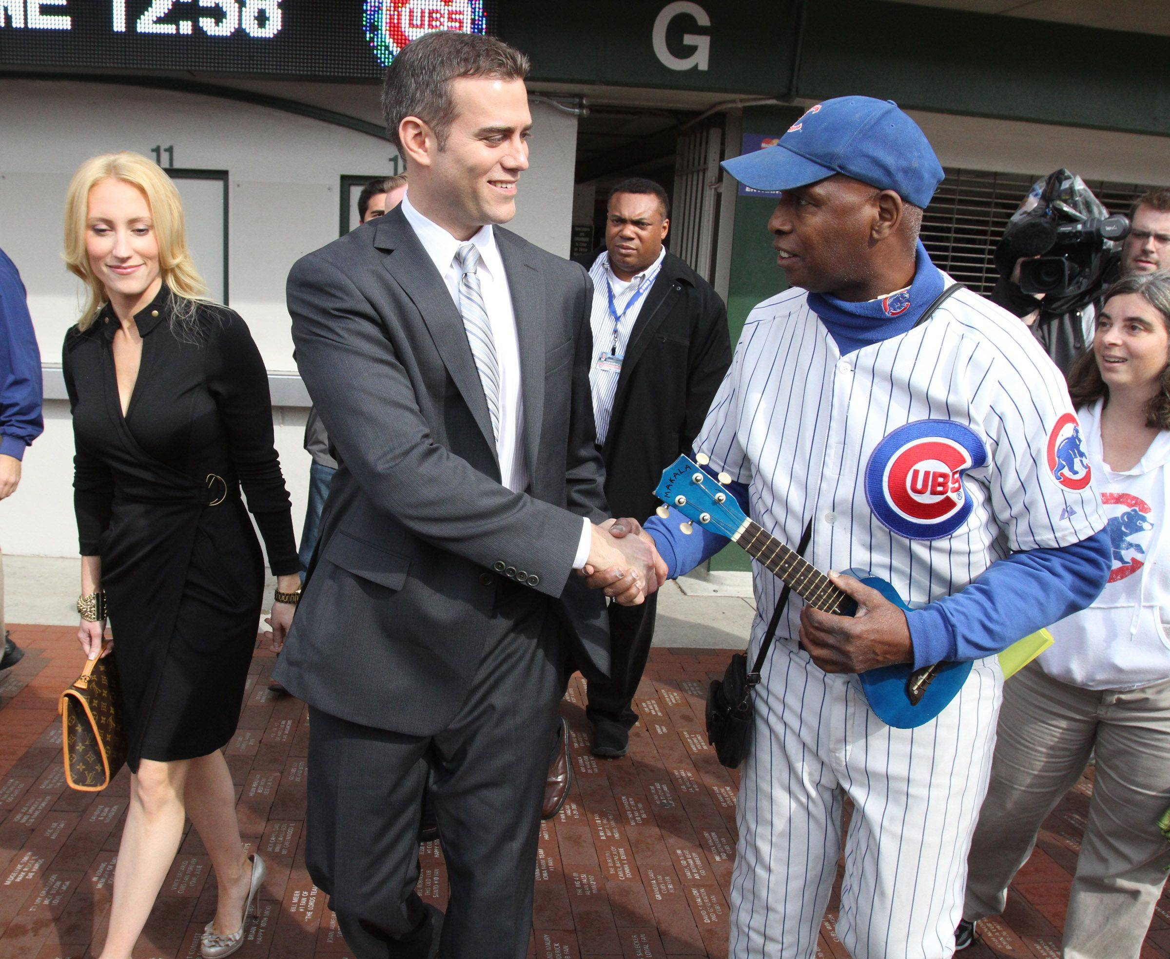"Ronnie ""Woo Woo"" Wickers is the first fan to greet Theo Epstein, Chicago Cubs president of baseball operations and his wife, Marie, during a tour of Wrigley Field in Chicago on Tuesday."