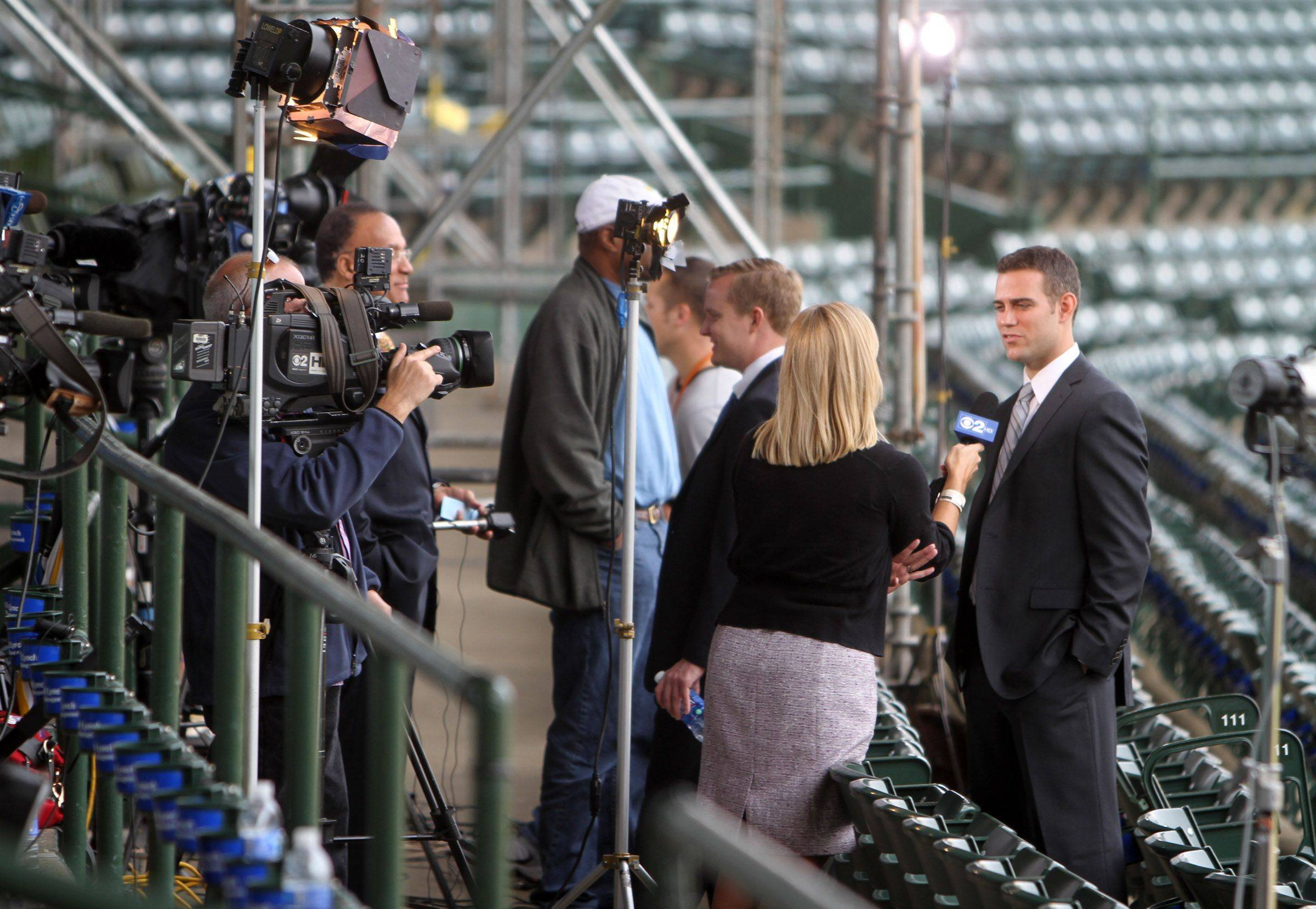 Television crews were lined up to interview Theo Epstein Chicago Cubs president of baseball at Wrigley Field in Chicago on Tuesday.