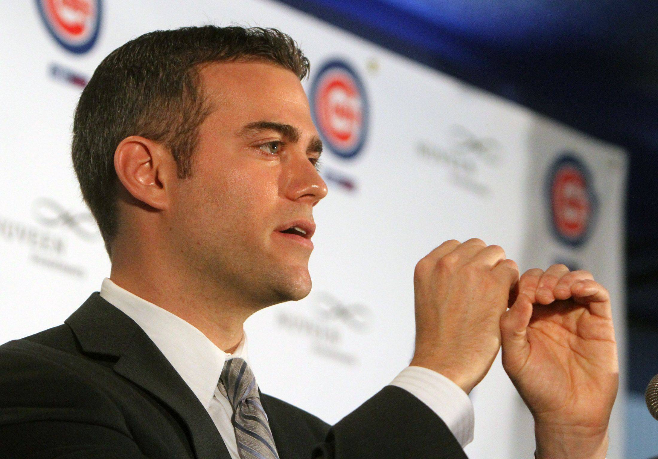 Chicago Cubs Chairman Tom Ricketts introduces Theo Epstein as the team's new president of baseball operations during a press conference at Wrigley Field in Chicago on Tuesday.
