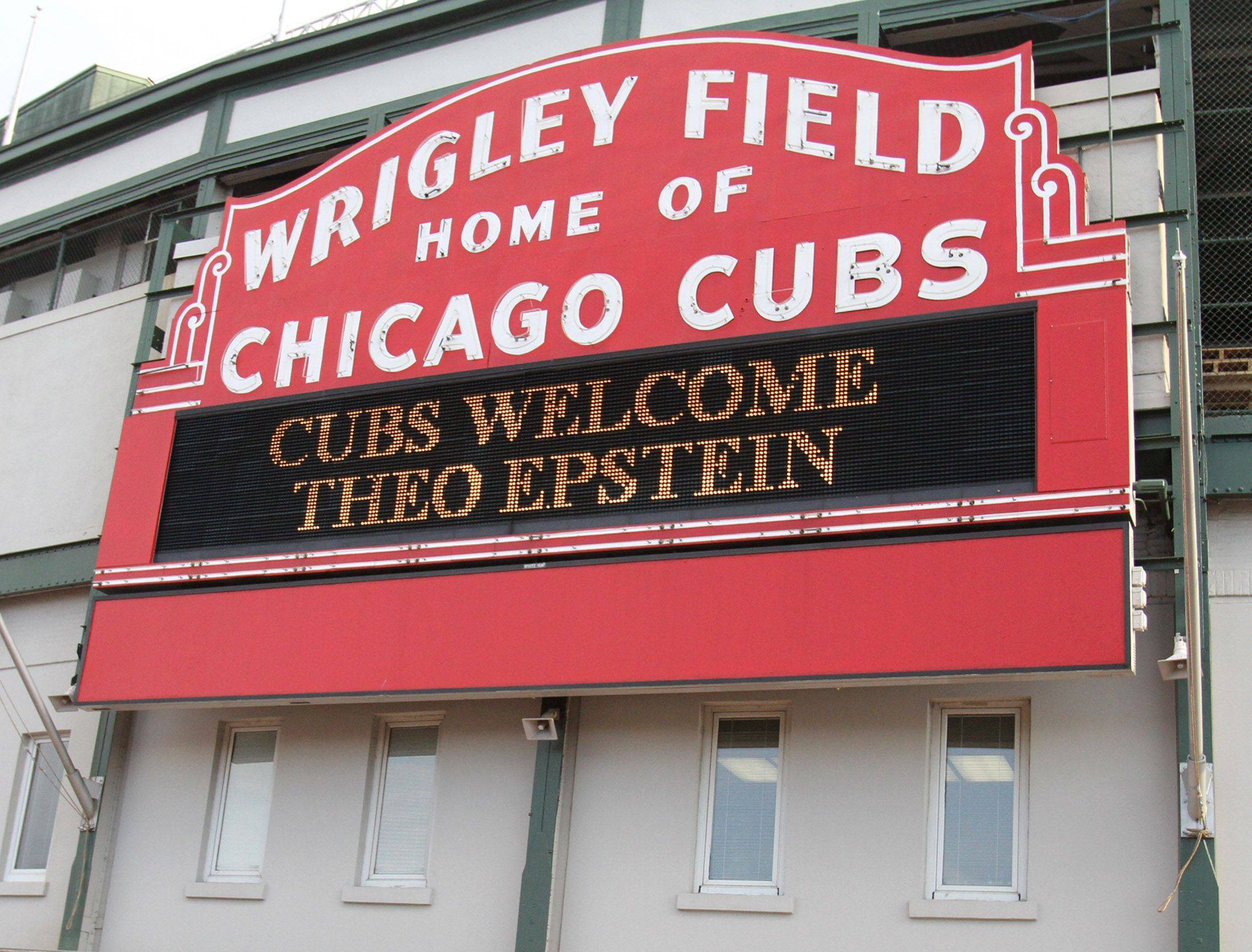 The Chicago Cubs stadium sign welcomes Theo Epstein to Wrigley Field in Chicago on Tuesday.