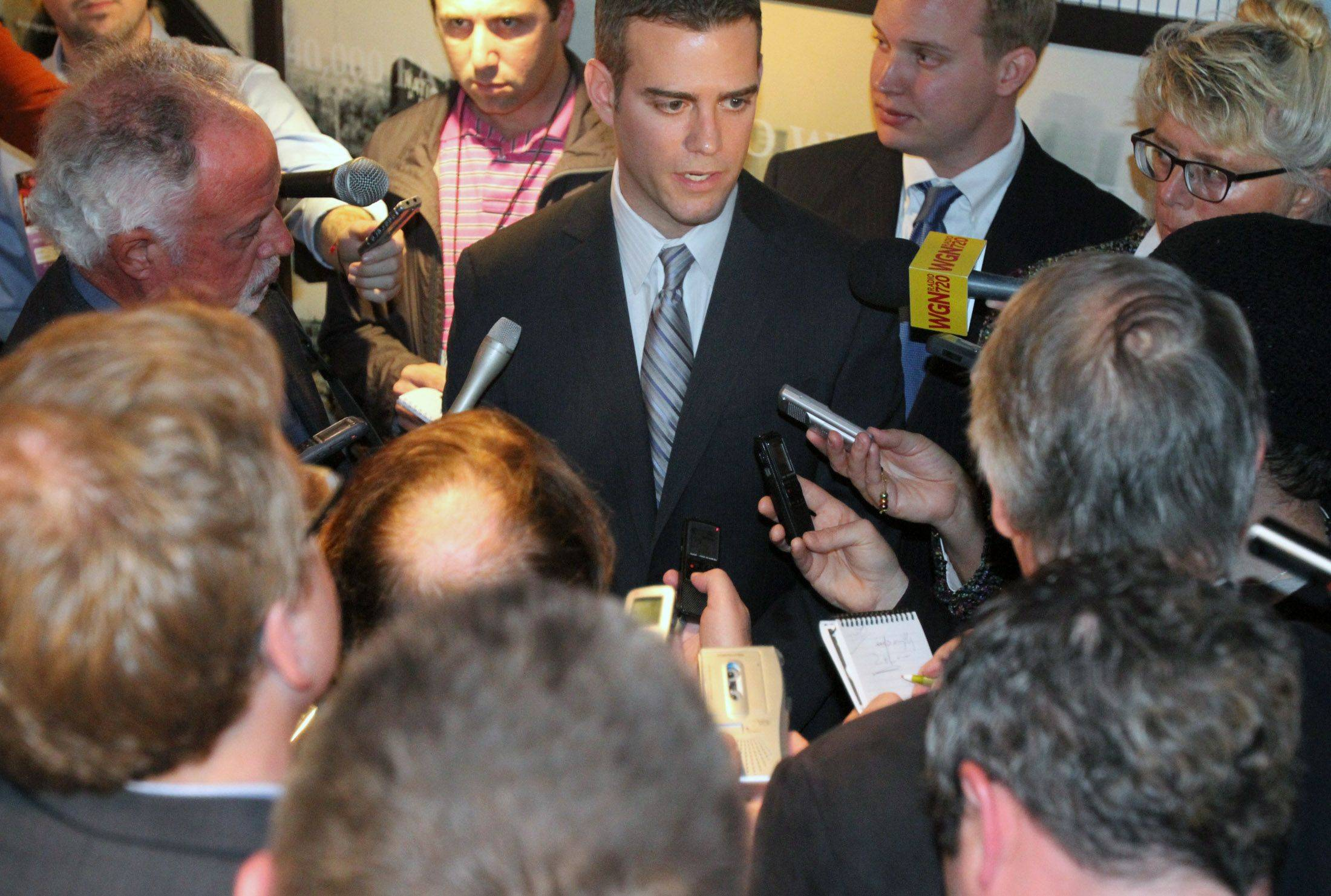 Theo Epstein, Chicago Cubs president of baseball operations, talks to the press in pockets after the press conference at Wrigley Field in Chicago on Tuesday.