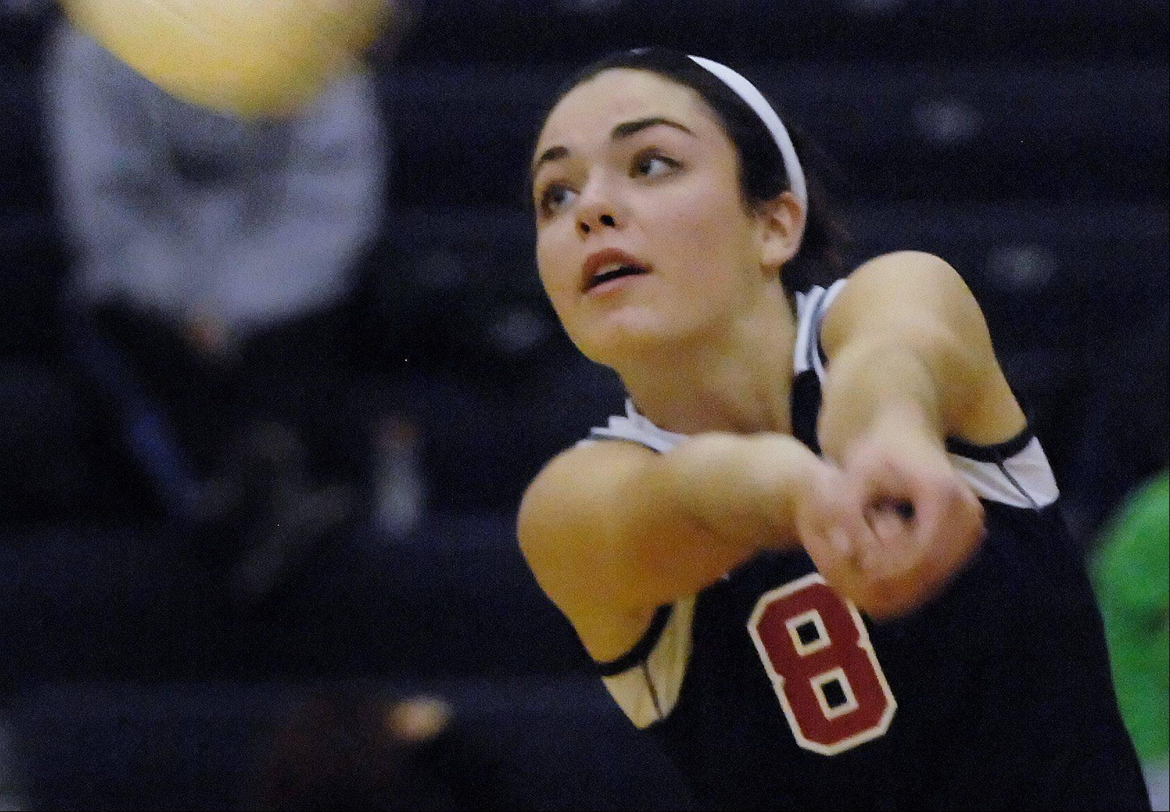 South Elgin's Sam Kummerer hits from midcourt Monday against St. Edward in South Elgin.
