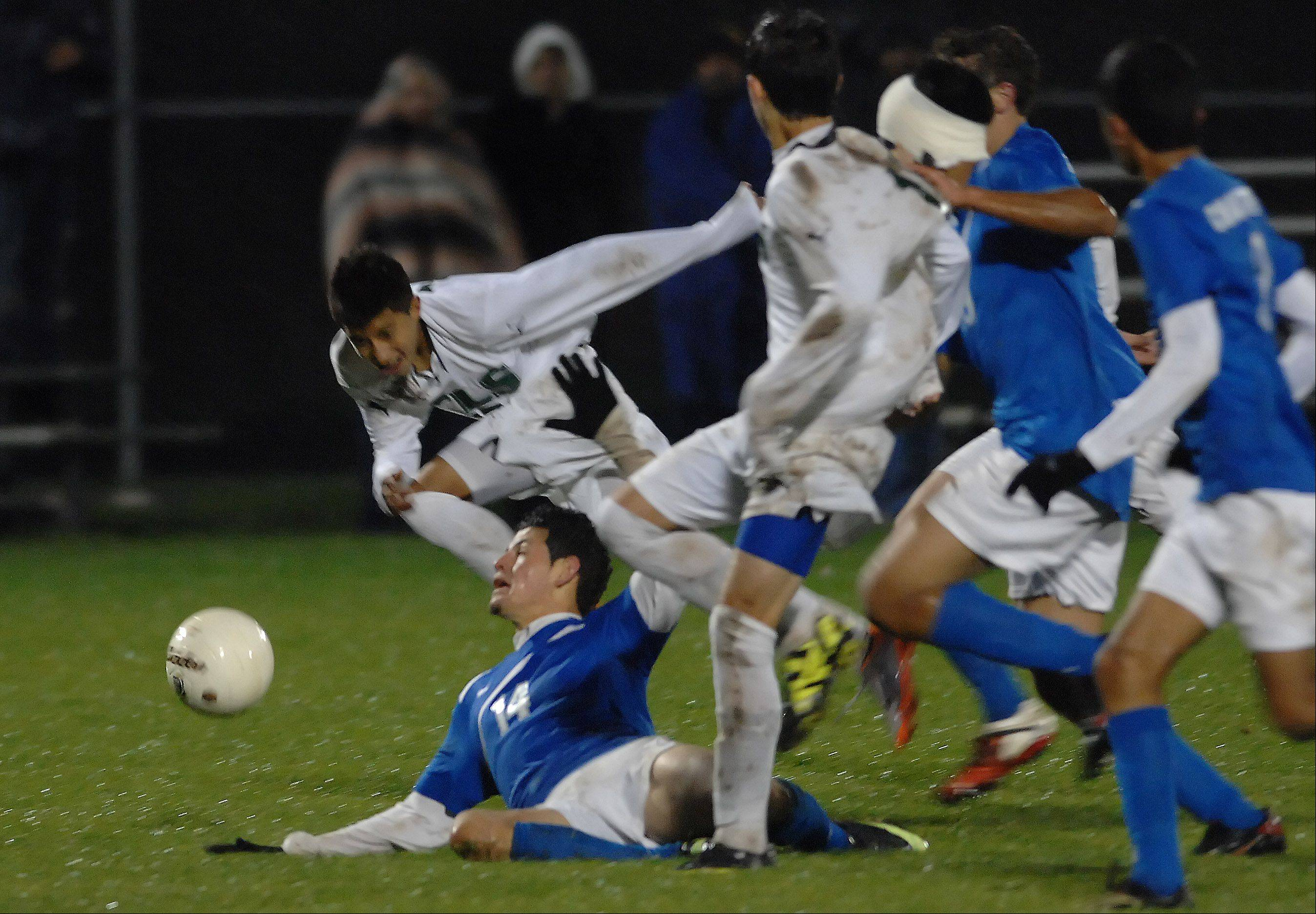 Dundee-Crown's Eduardo Arellano is trampled in the rain during Wednesday's soccer match in Algonquin.