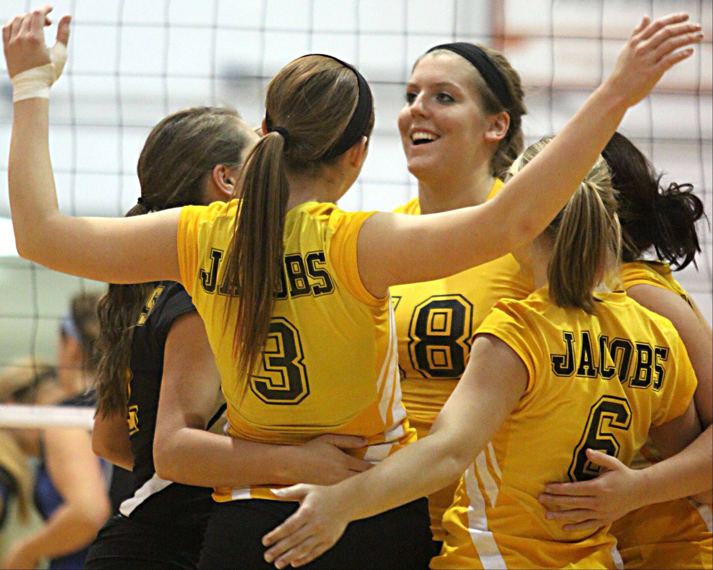 Nikki Madoch, center, and other Jacobs players celebrate their victory over Dundee-Crown Thursday.