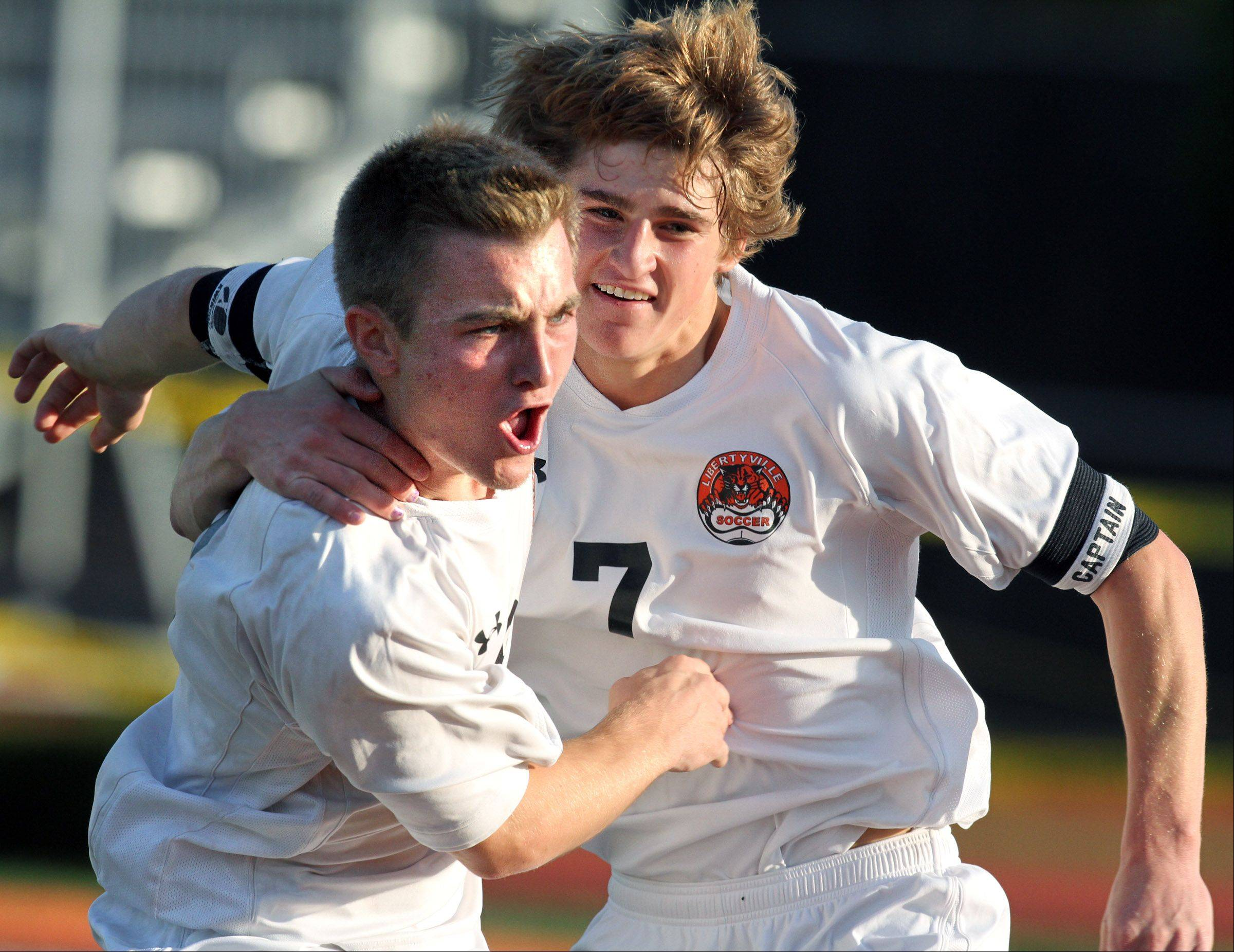 Libertyville's Joey Ruppert, left, celebrates scoring the games' first goal with teammate Marshall Hollingsworth Saturday.